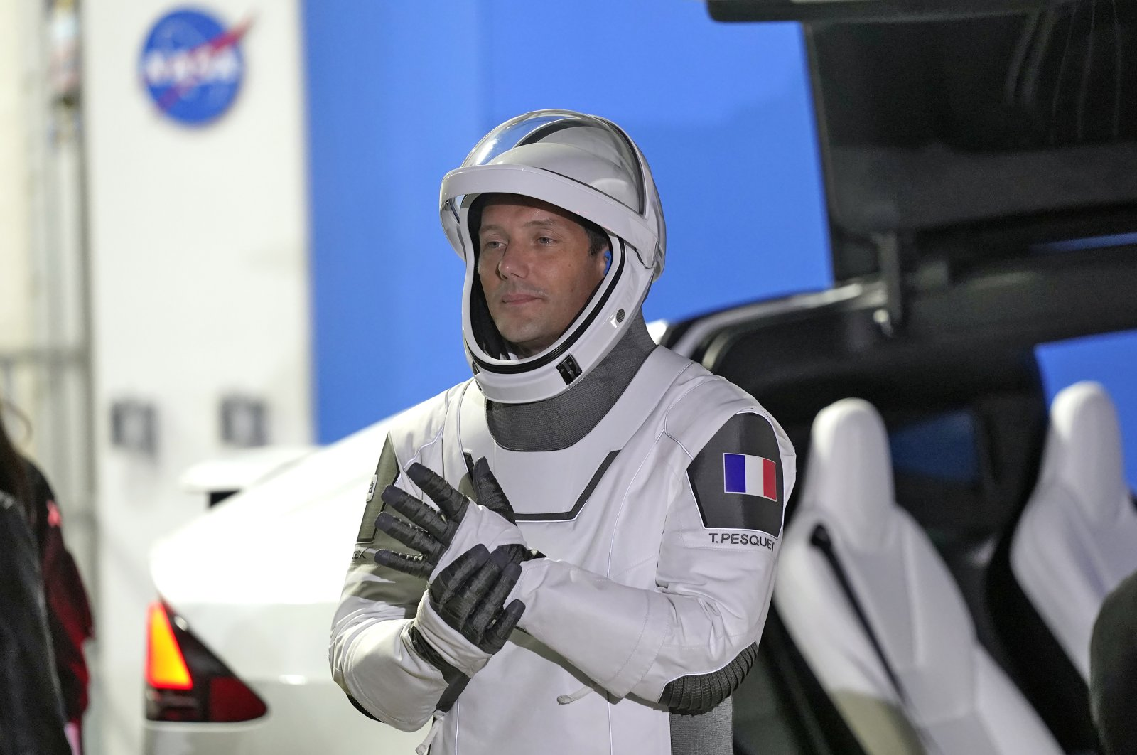 European Space Agency astronaut Thomas Pesquet of France, adjusts his glove as he talks to family and friends before a launch attempt at the Kennedy Space Center in Cape Canaveral, Fla., April 23, 2021. (AP File Photo)
