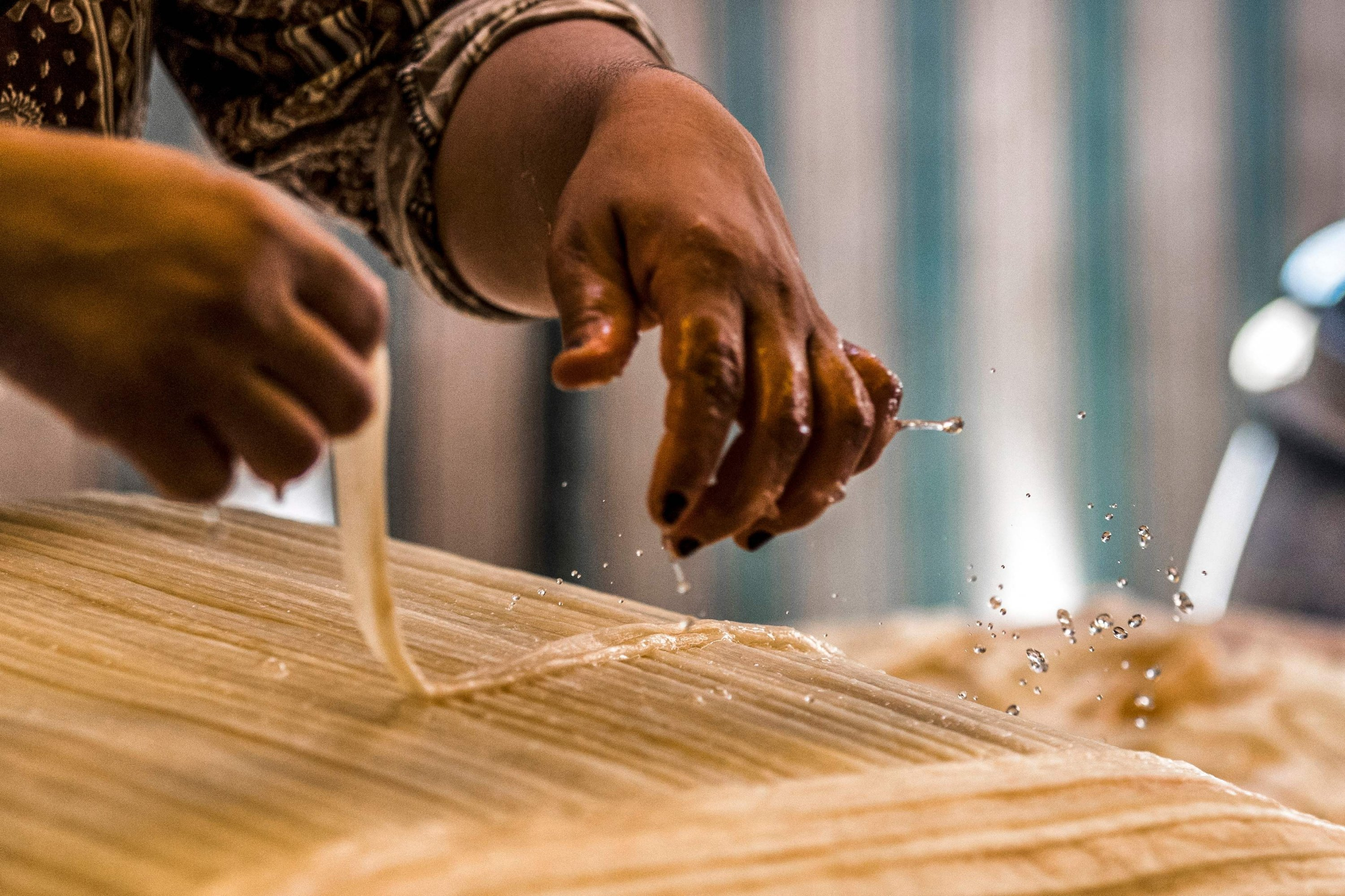 A woman prepares papyrus to compress and dry it at the workshop in the village of al-Qaramous in Sharqiyah province, in Egypt