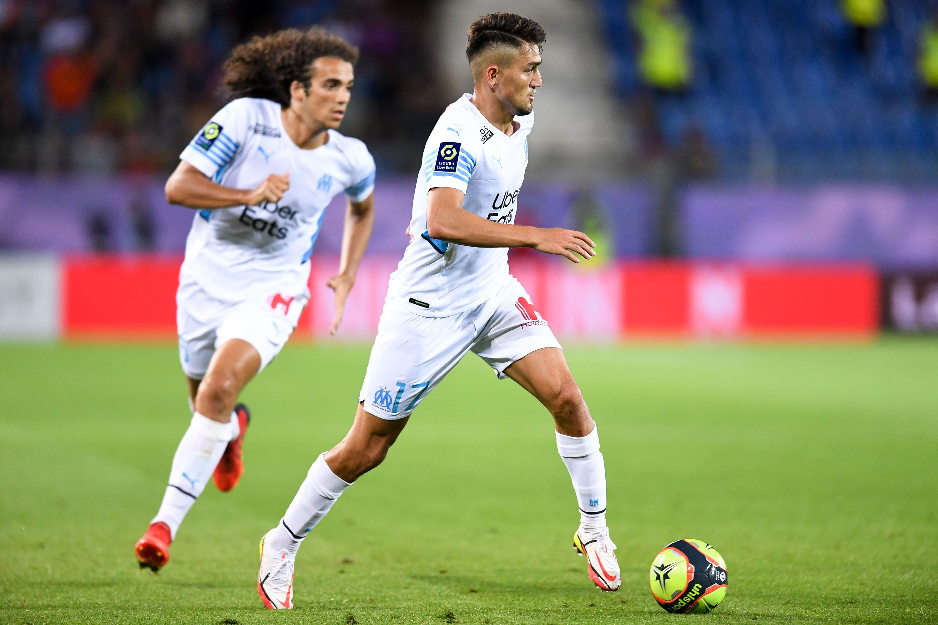 Marseille winger Cengiz Ünder (R) in action against Montpellier during a Ligue 1 match, Montpellier, France, Aug. 8, 2021.