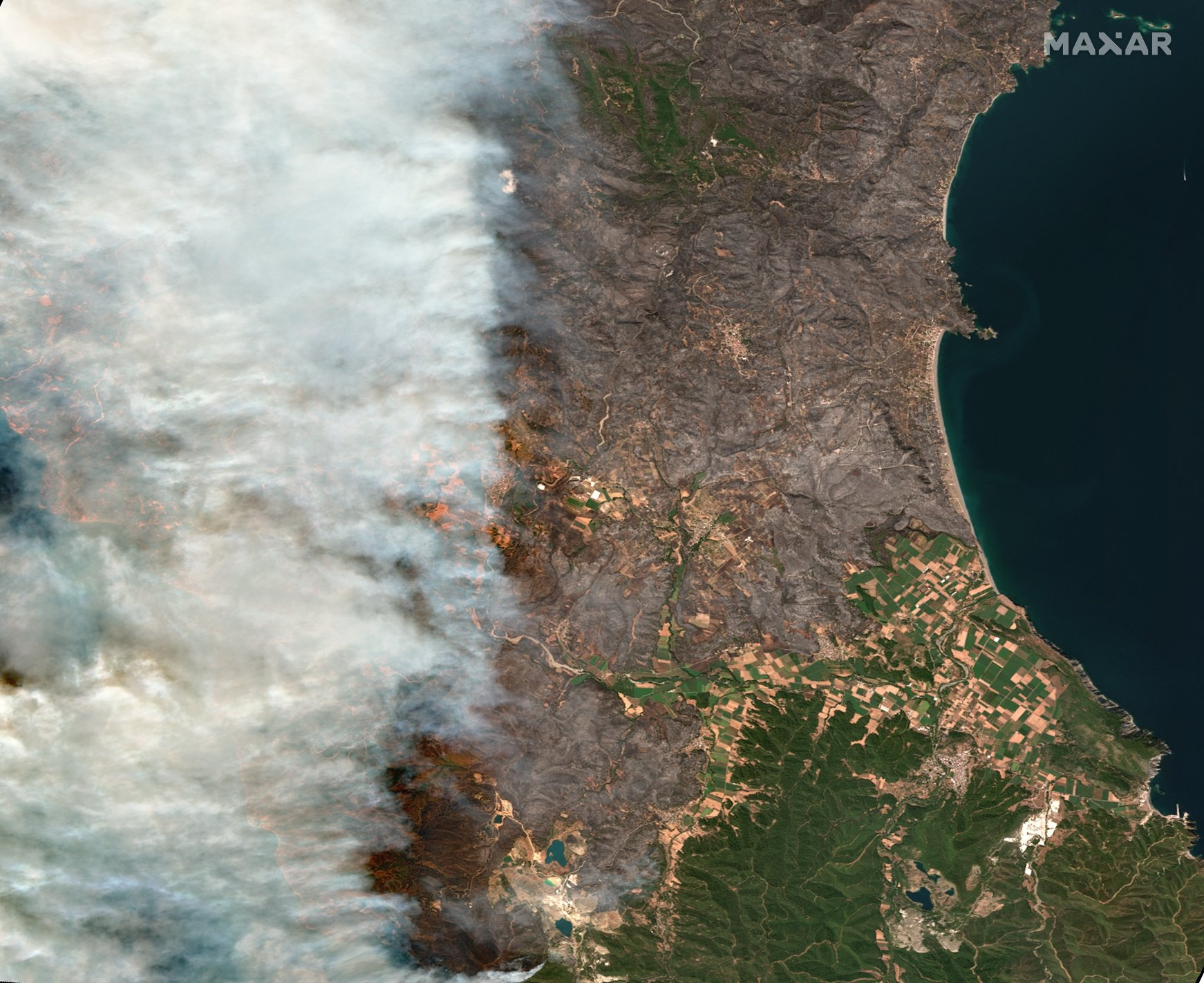 In this satellite image provided by Maxar Technologies wildfires burn north of Athens, Greece on the island of Evia, where some of the most destructive and active fires continue to burn, Aug. 8, 2021.  (Satellite image ©2021 Maxar Technologies via AP)