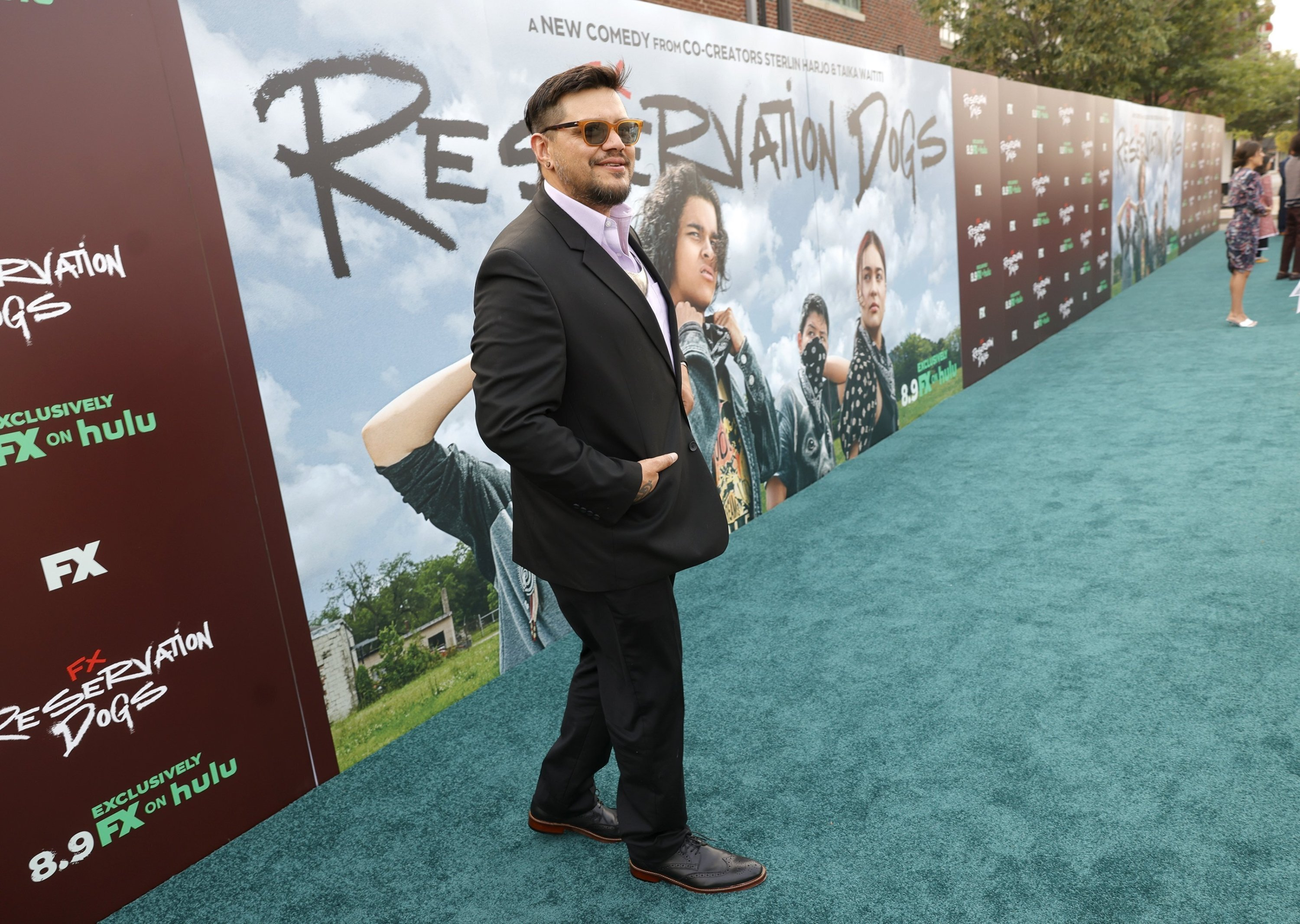 """Filmmaker Sterlin Harjo speaks to a reporter, for the premier of FX's """"Reservation Dogs,"""" a new series created by Harjo and Taika Waititi, outside the Circle Cinema in Tulsa, Oklahoma, U.S., Aug. 2, 2021. (AP Photo)"""