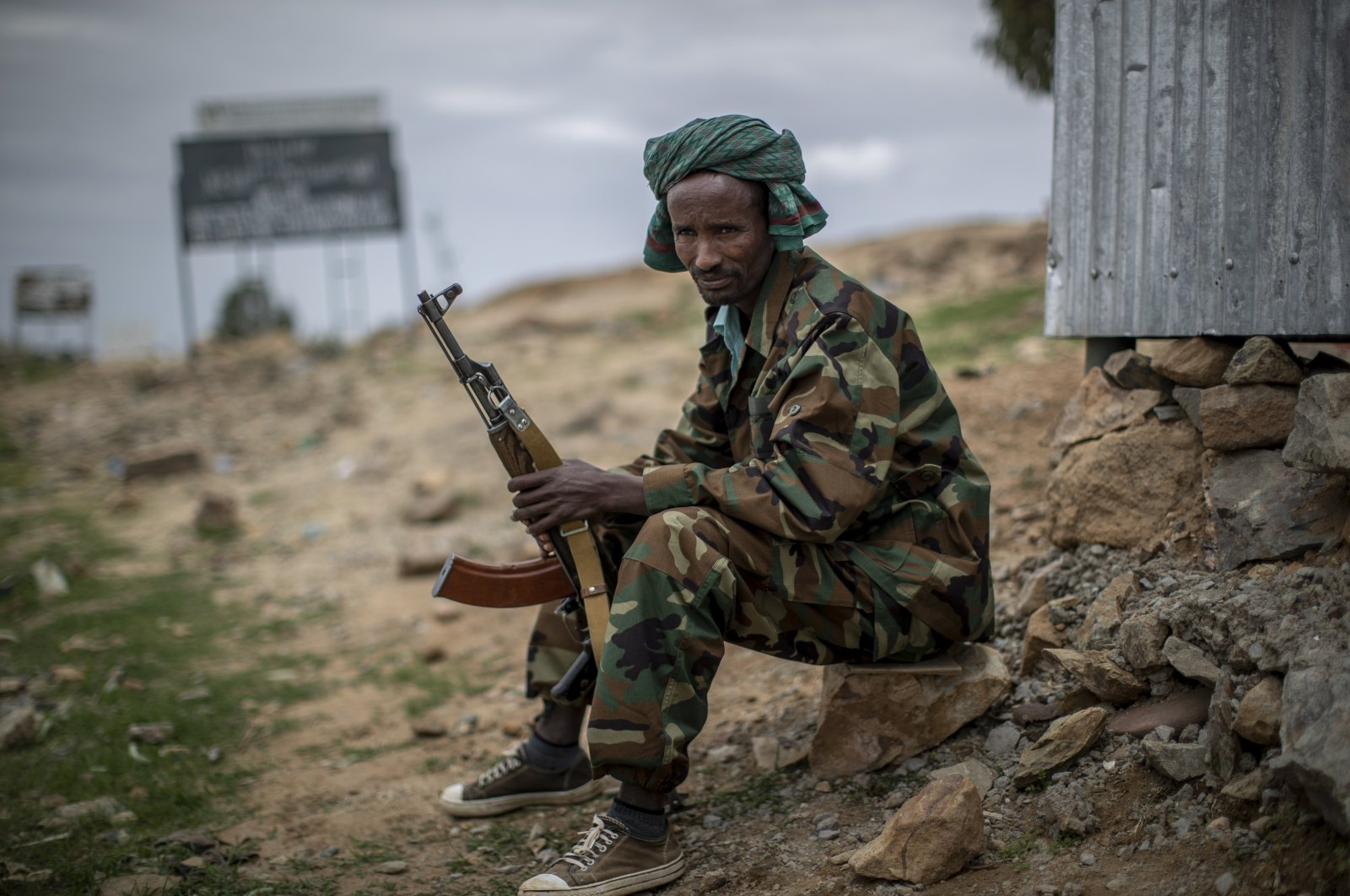 A fighter loyal to the Tigray People's Liberation Front (TPLF) mans a guard post on the outskirts of the town of Hawzen, then controlled by the group but later retaken by government forces, in the Tigray region of northern Ethiopia, May 7, 2021. (AP Photo)