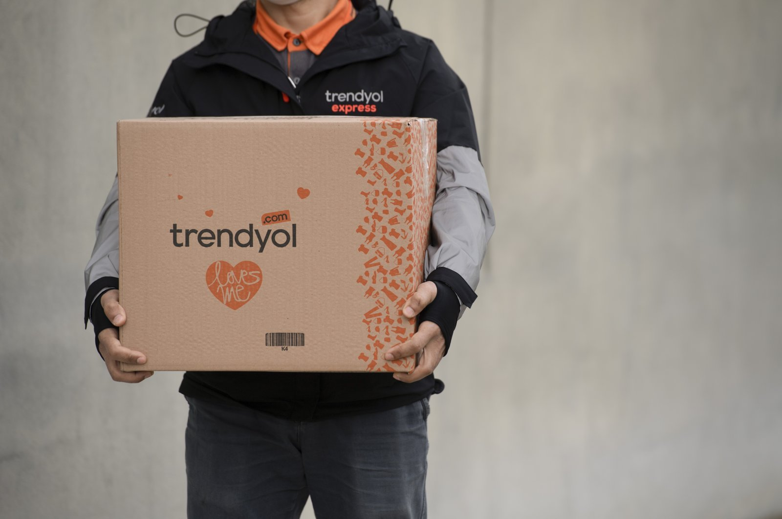 A Trendyol worker holds a package in this undated photo. (Courtesy of Trendyol)