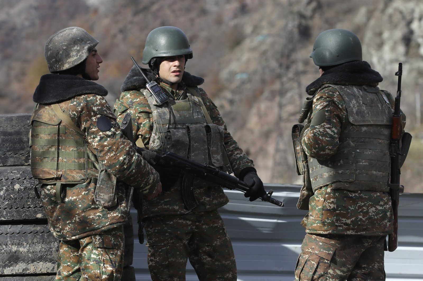 Armenian militants stand at a checkpoint near the village of Charektar in the occupied region of Nagorno-Karabakh at a new border with the Kalbajar district turned over to Azerbaijan, Nov. 25, 2020. (AP File Photo)