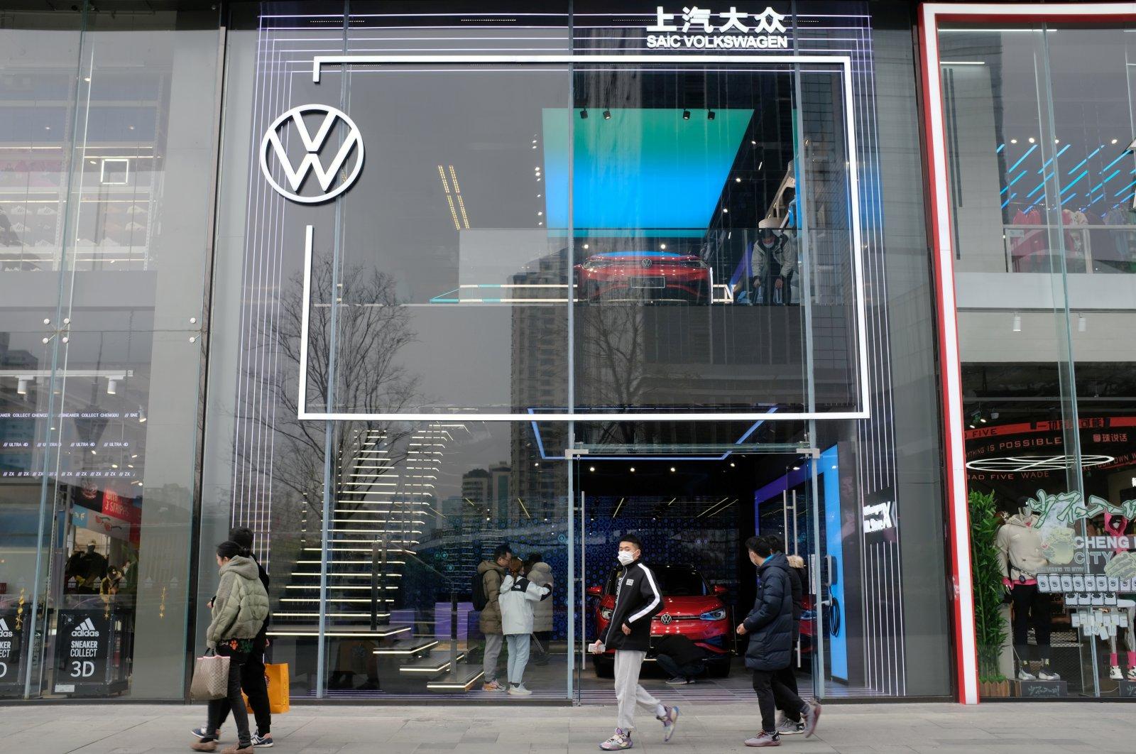 People walk past a showroom of SAIC Volkswagen in Chengdu, Sichuan province, China, Jan. 10, 2021. (Reuters Photo)