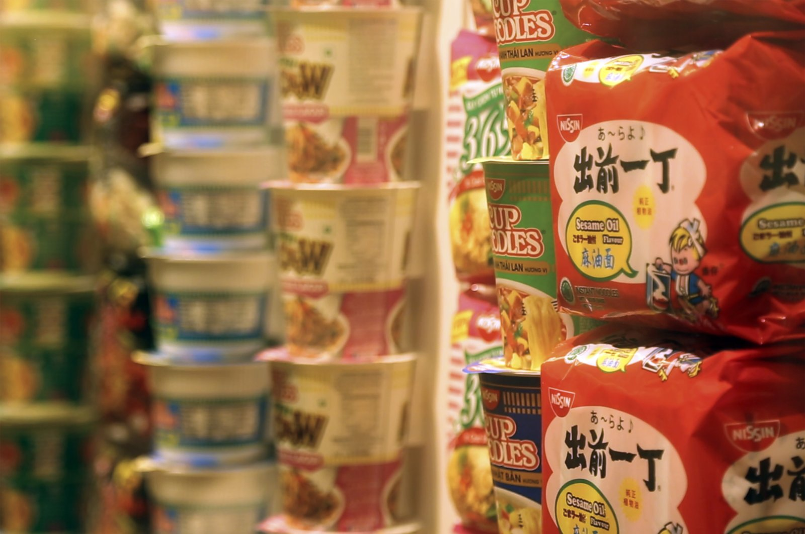 In this frame from video, packets of instant noodles sit on display in the Cup Noodles Museum in Yokohama, Japan, Friday, Aug. 6, 2021. (AP Photo)