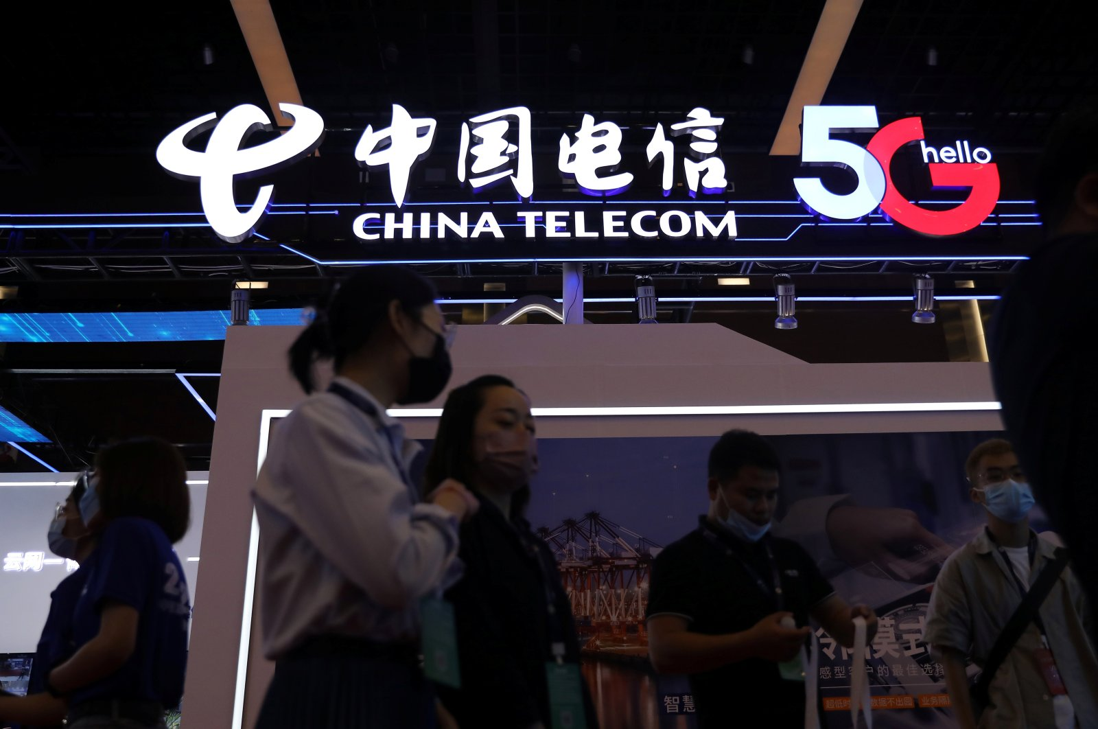 People are seen at a China Telecom booth at an exhibition during China Internet Conference in Beijing, China, July 13, 2021. (Reuters Photo)