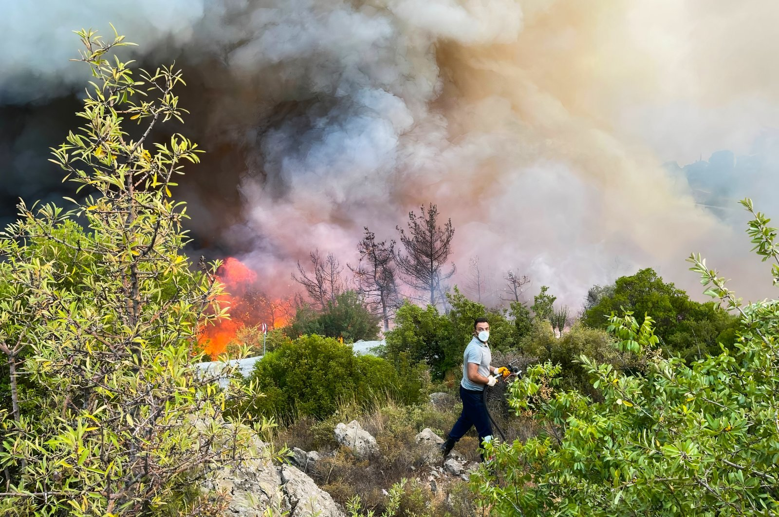 Flames and smoke raise from a wildfire in Ören, in the holiday region of Muğla, southwestern Turkey, Aug. 6, 2021. (IHA Photo)