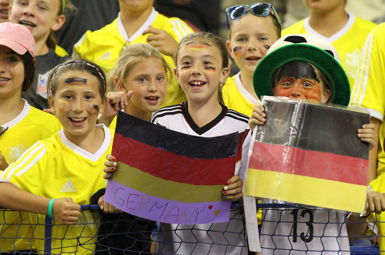Kids cheering for team Germany during the FIFA Women's World Cup Canada 2015 quarterfinal match between Germany and France at Olympic Stadium in Montreal, Canada, on June 26, 2015. (Getty Images)