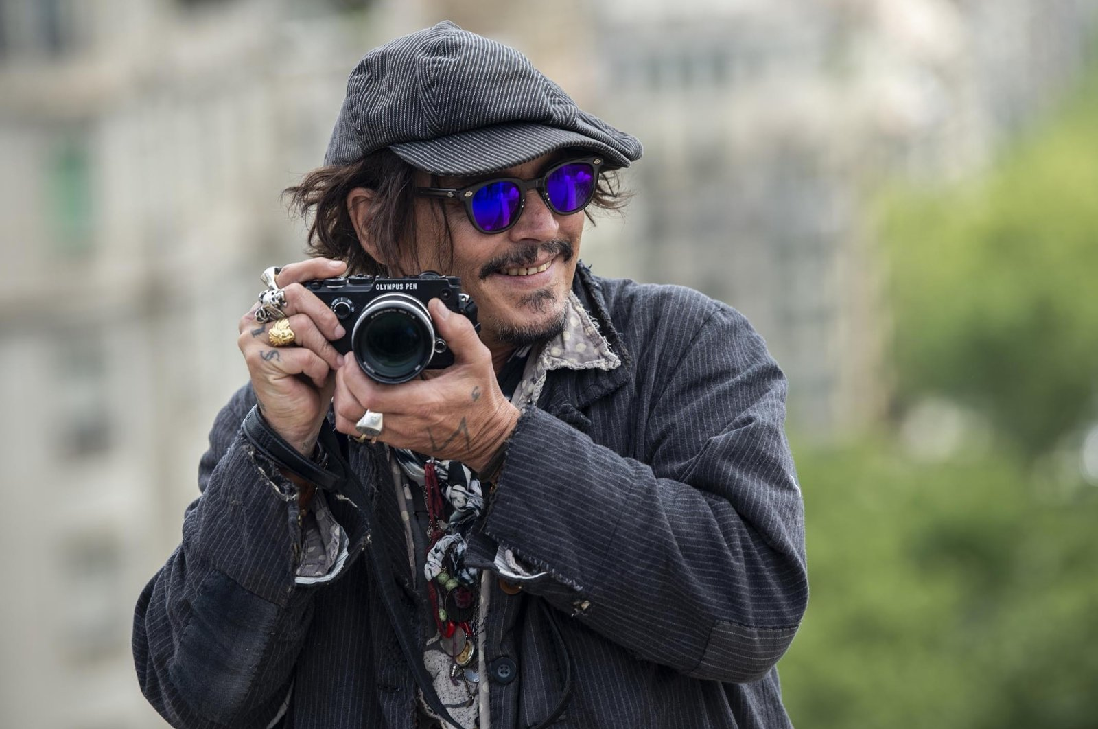 """American actor Johnny Depp attends a photocall for his latest film""""Minamata"""" during BCN Film Festival at Hotel Casa Fuster in Barcelona, Spain,April 16, 2021. (Getty Images)"""