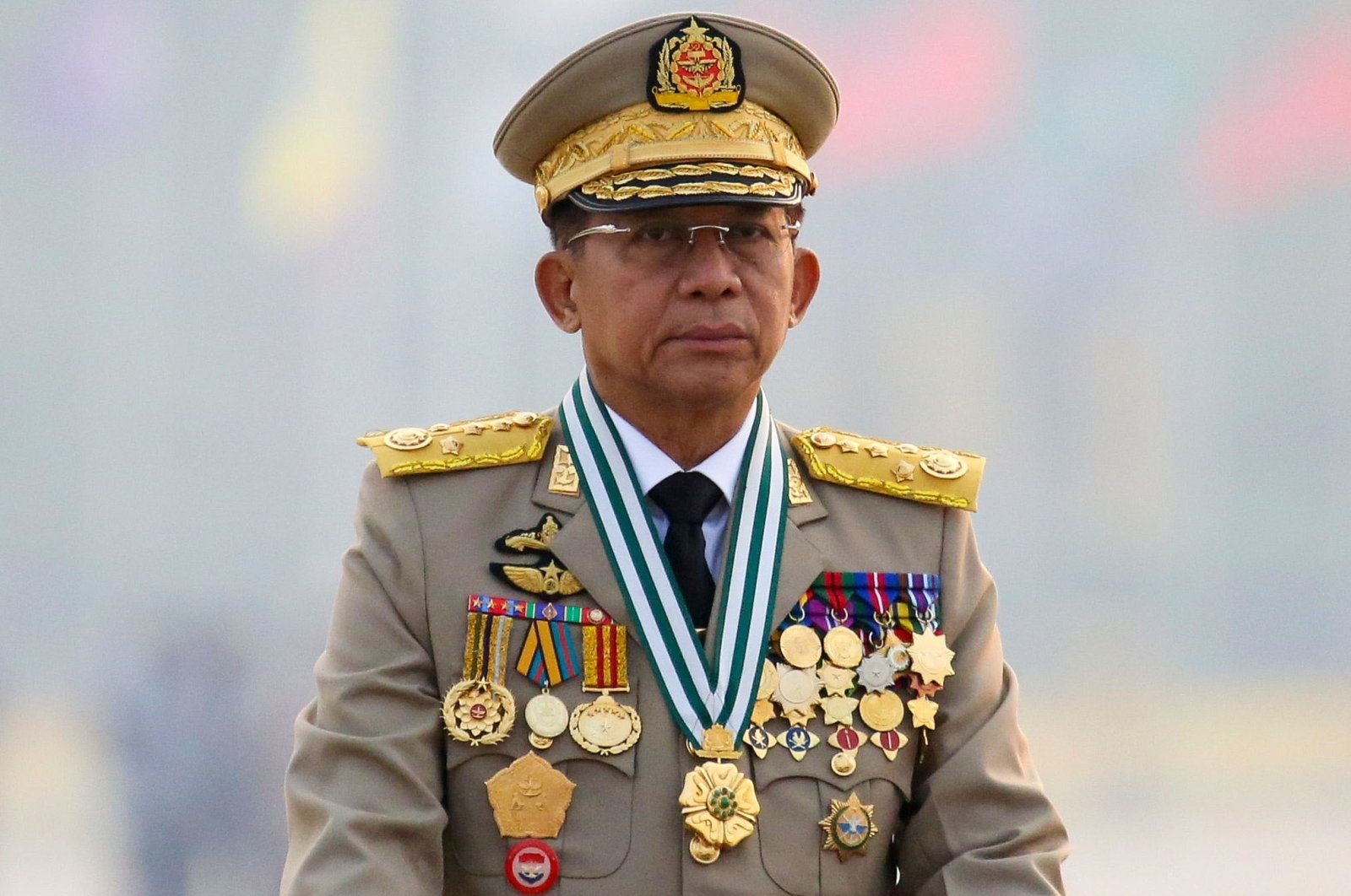 Myanmar's junta chief, Senior Gen. Min Aung Hlaing, who ousted the elected government in a coup on Feb. 1, presides over an army parade on Armed Forces Day in Naypyitaw, Myanmar, March 27, 2021. (Reuters File Photo)