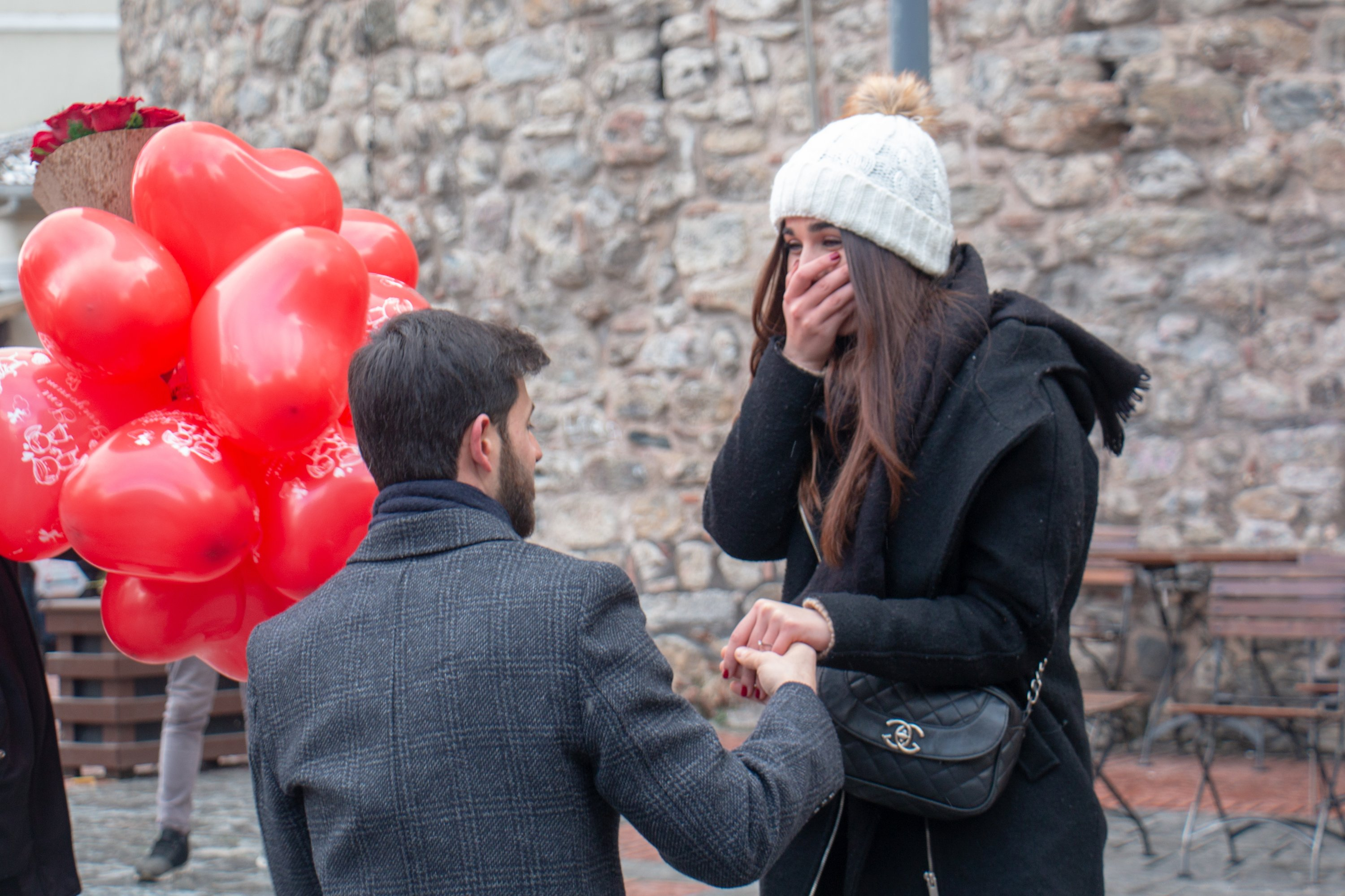 A man proposing to a woman next to Istanbul's Galata Tower. (Shutterstock Photo)