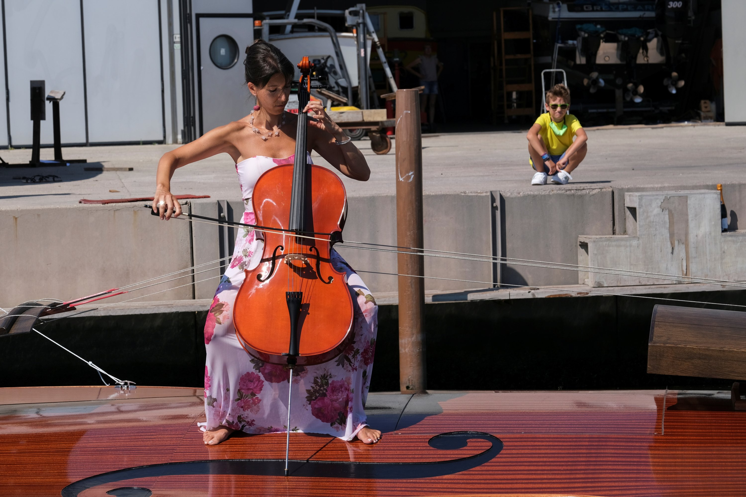 A musician plays a cello onboard a boat in the shape of a violin, titled 'Violin of Noah', that was built during the pandemic by artist Livio De Marchi in collaboration with Consorzio Venezia Sviluppo and is dedicated to people who have died from coronavirus, during a test-ride, in Venice, Italy, August 6, 2021. (Reuters Photo)