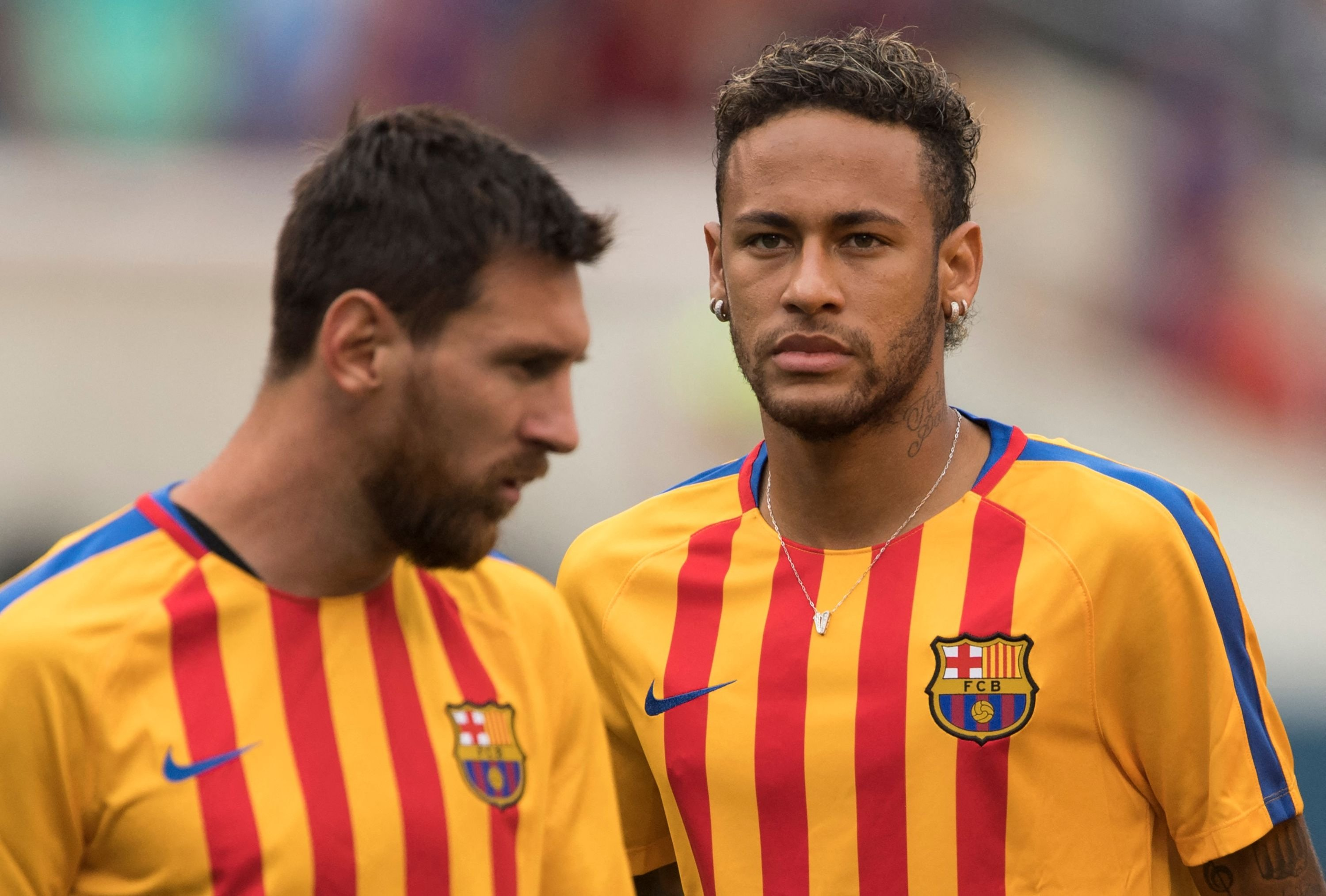 This file photograph shows then-Barcelona player Neymar (R) and Lionel Messi (L) warming up before the International Champions Cup (ICC) match against Juventus at the Met Life Stadium in East Rutherford, New Jersey, U.S., July 22, 2017.