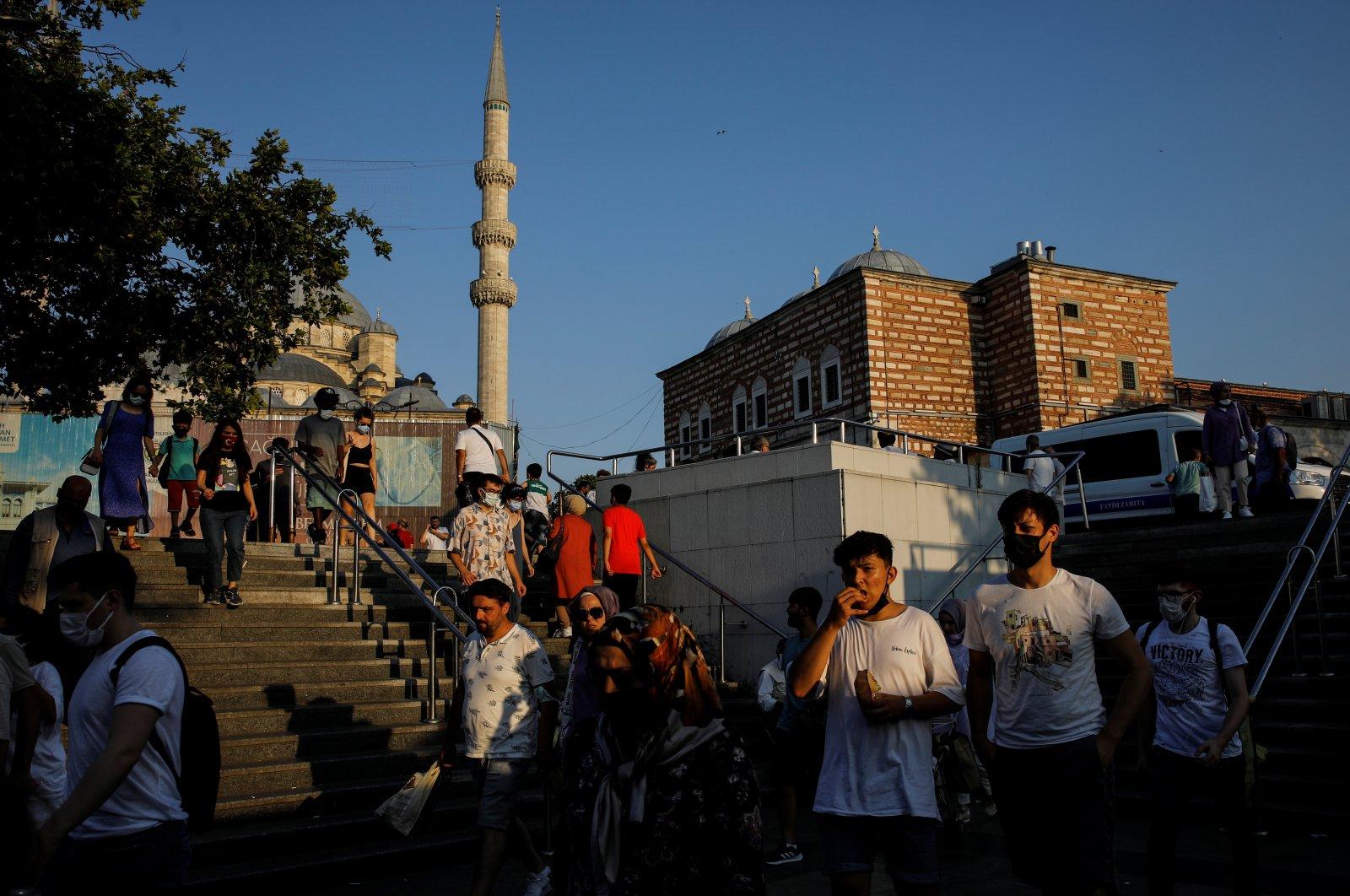 People walk along the Eminönü neighborhood in Istanbul, Turkey, July 12, 2021. (Reuters Photo)