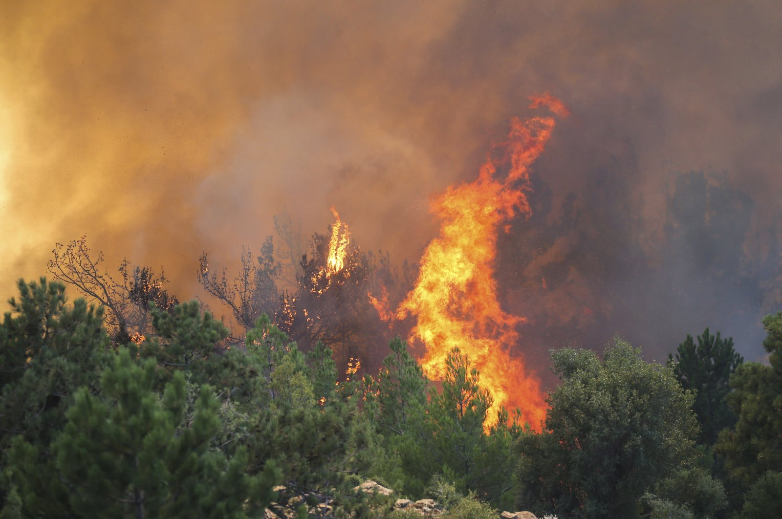 View of a wildfire in Köyceğiz district, in Muğla, southwestern Turkey, Aug. 9, 2021. (AP PHOTO)