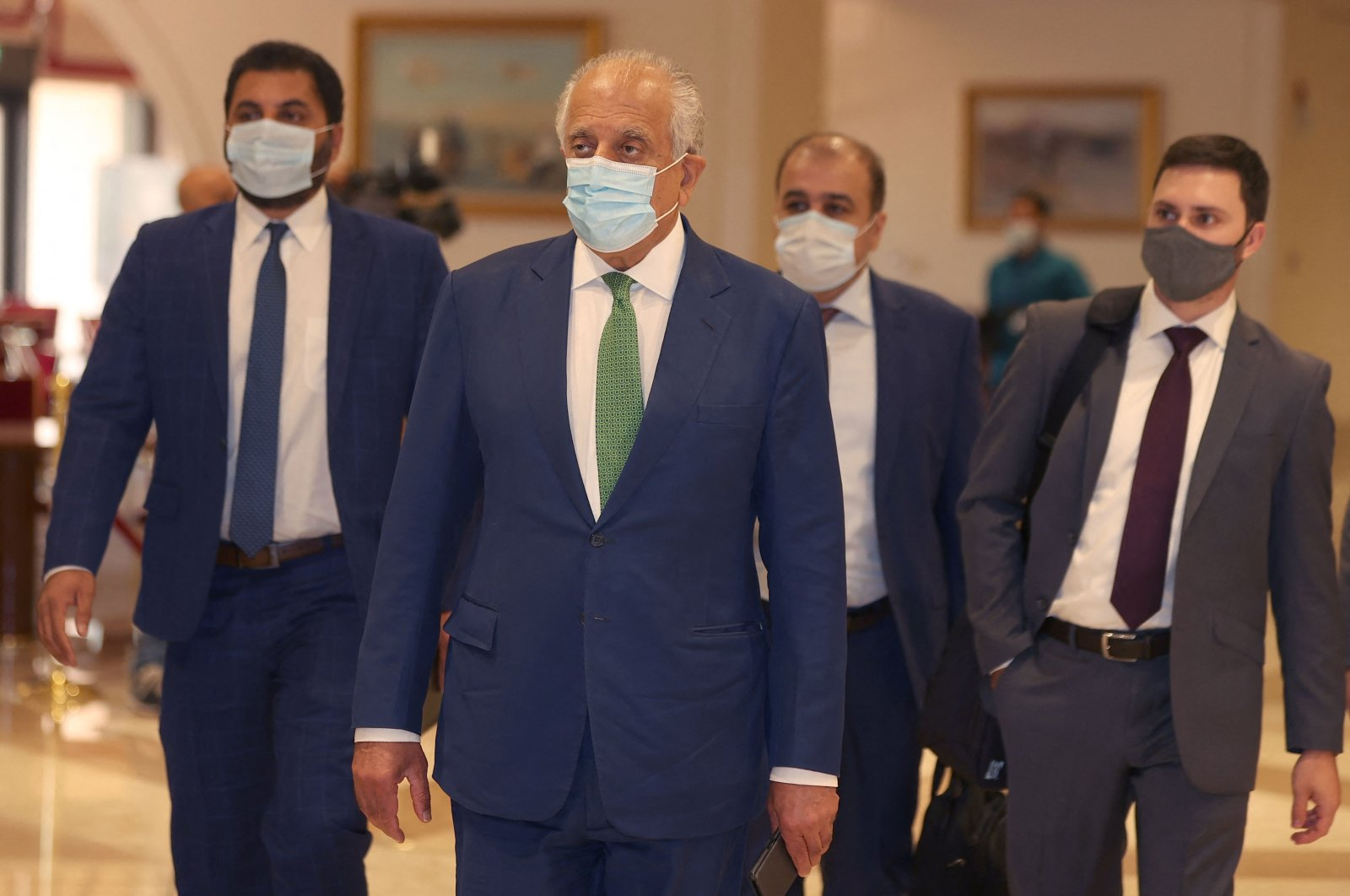 U.S. special envoy for Afghanistan, Zalmay Khalilzad (2nd L), arrives at a hotel for an international meeting on the escalating conflict in Afghanistan, in Doha, Qatar, Aug. 10, 2021. (AFP Photo)
