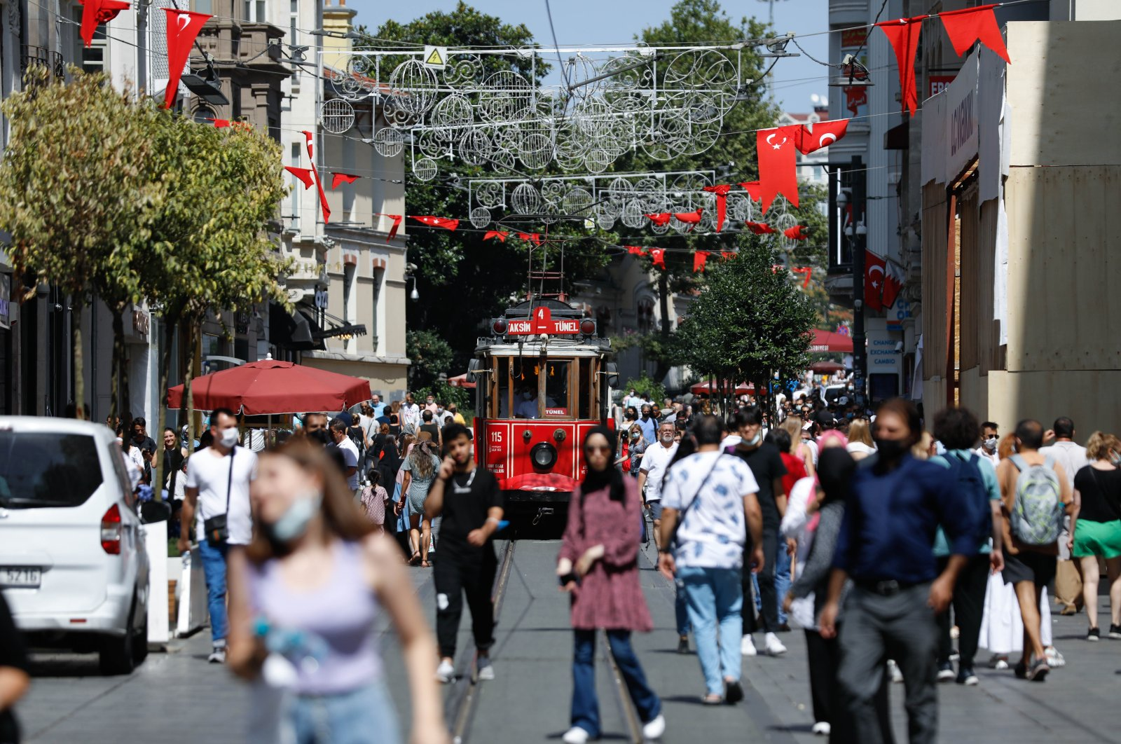 People with masks walk on Istiklal Street, Istanbul, Turkey, July 30, 2021. (DHA Photo)