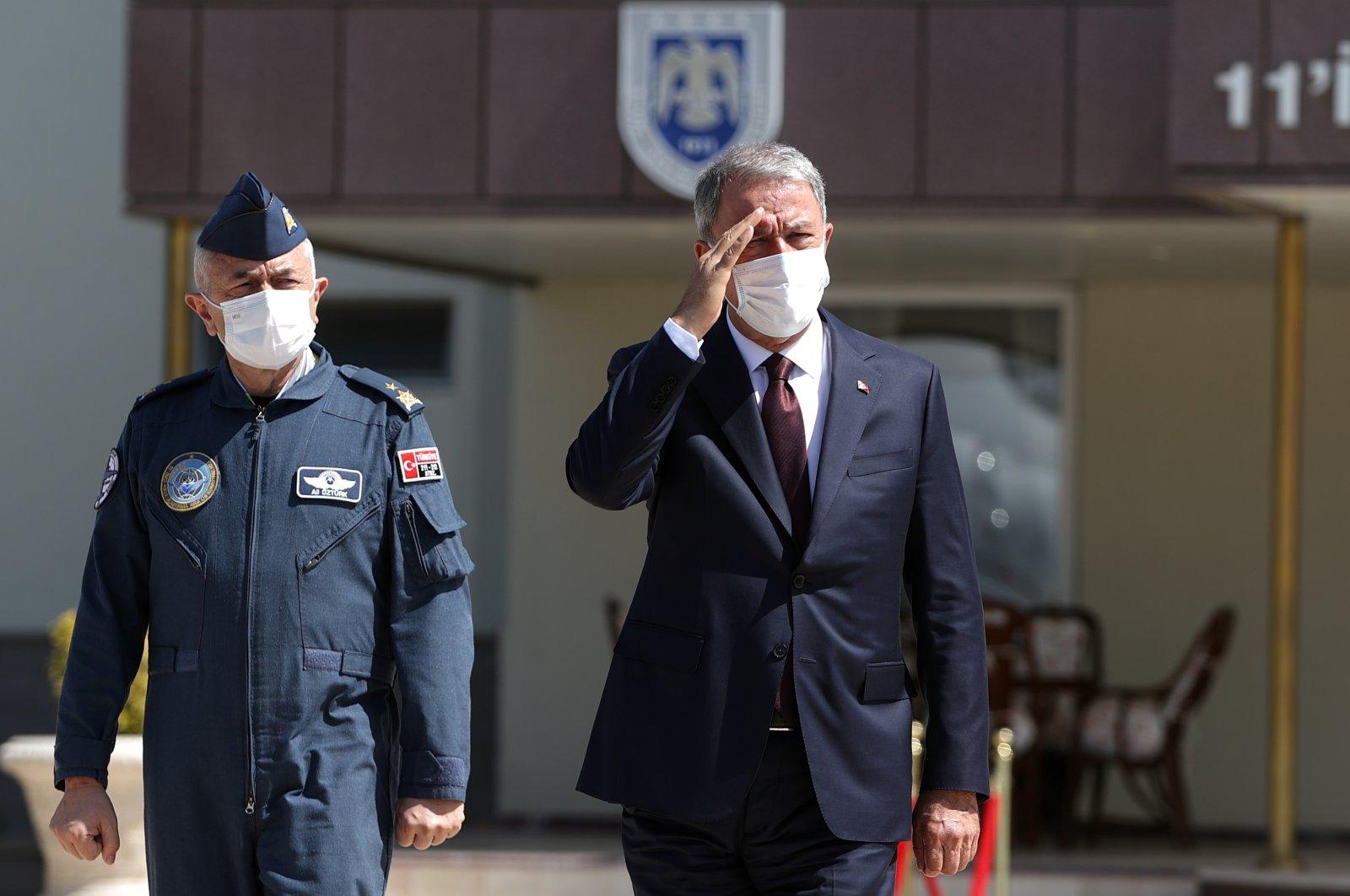 Defense Minister Hulusi Akar departs for Pakistan, in the capital Ankara, Turkey, Aug. 10, 2021.