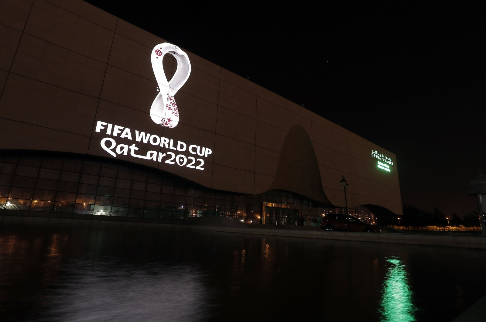 The 2022 Qatar World Cup logo is projected on the opera house of Algiers, Algeria, Sept. 3, 2019. (AP Photo)