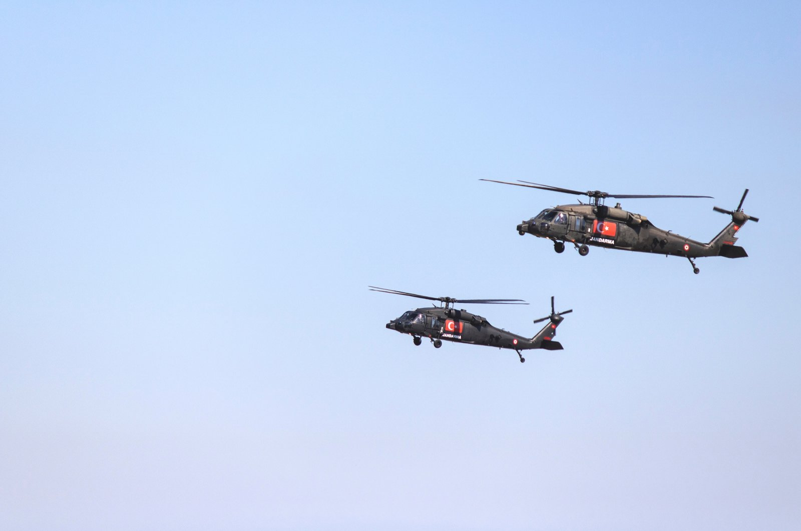 A Sikorsky S-70A-28 and a Blackhawk helicopter belonging to the Gendarmerie General Command are seen in the air during Teknofest, Istanbul, Turkey, on Sept. 18, 2019. (Shutterstock Photo)