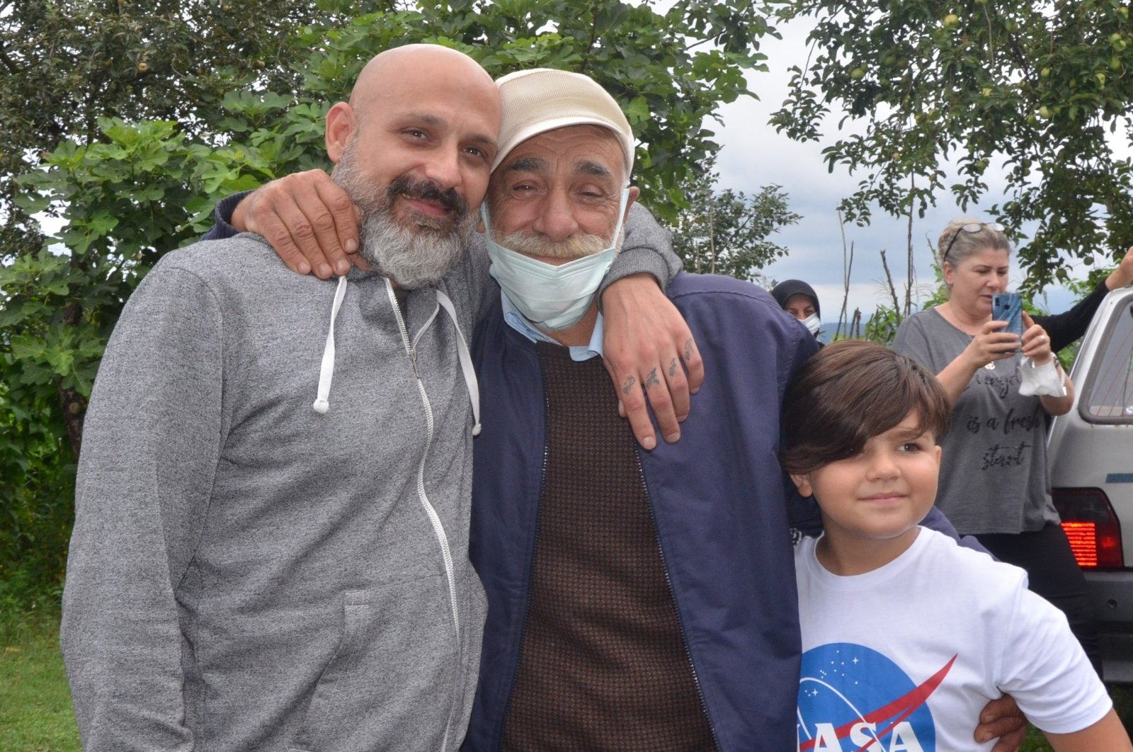 Osman Zerey (C) poses with his son Salvatore (L) and his grandson (R), in Ordu, northern Turkey, Aug. 10, 2021. (IHA PHOTO)