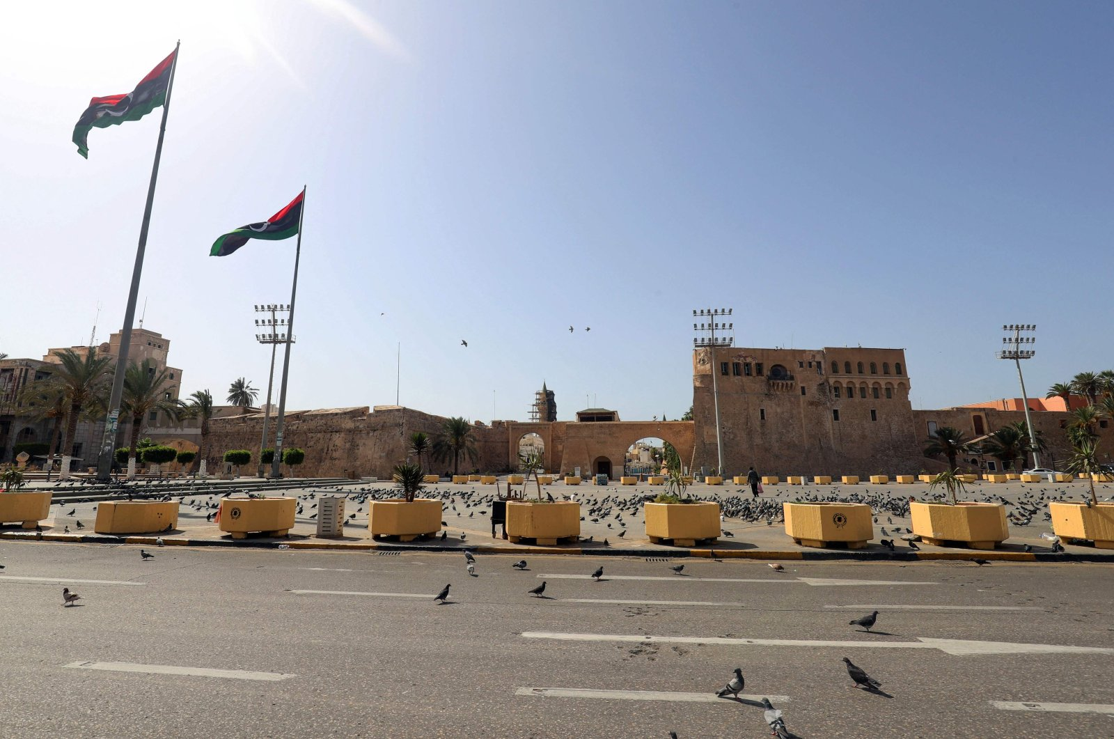 Pigeons fill the almost-empty Martyrs square a day after the authorities announced a total curfew throughout the weekend, to mitigate the spread of the COVID-19 pandemic, in the capital Tripoli, Libya, Aug. 7, 2021. (AFP Photo)