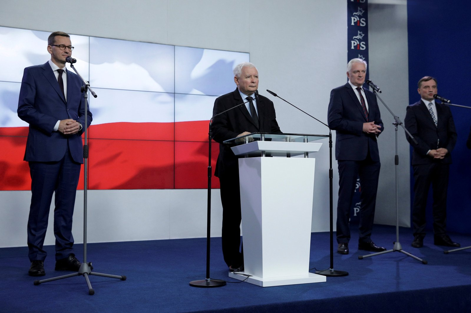 In this photo (L-R) Poland's Prime Minister Mateusz Morawiecki, leader of Law and Justice party Jaroslaw Kaczynski, leader of Agreement party Jaroslaw Gowin, and leader of United Poland party Justice Minister Zbigniew Ziobro, attend a news conference after signing coalition agreement in Warsaw, Poland, Sept. 26, 2020. (Reuters Photo)