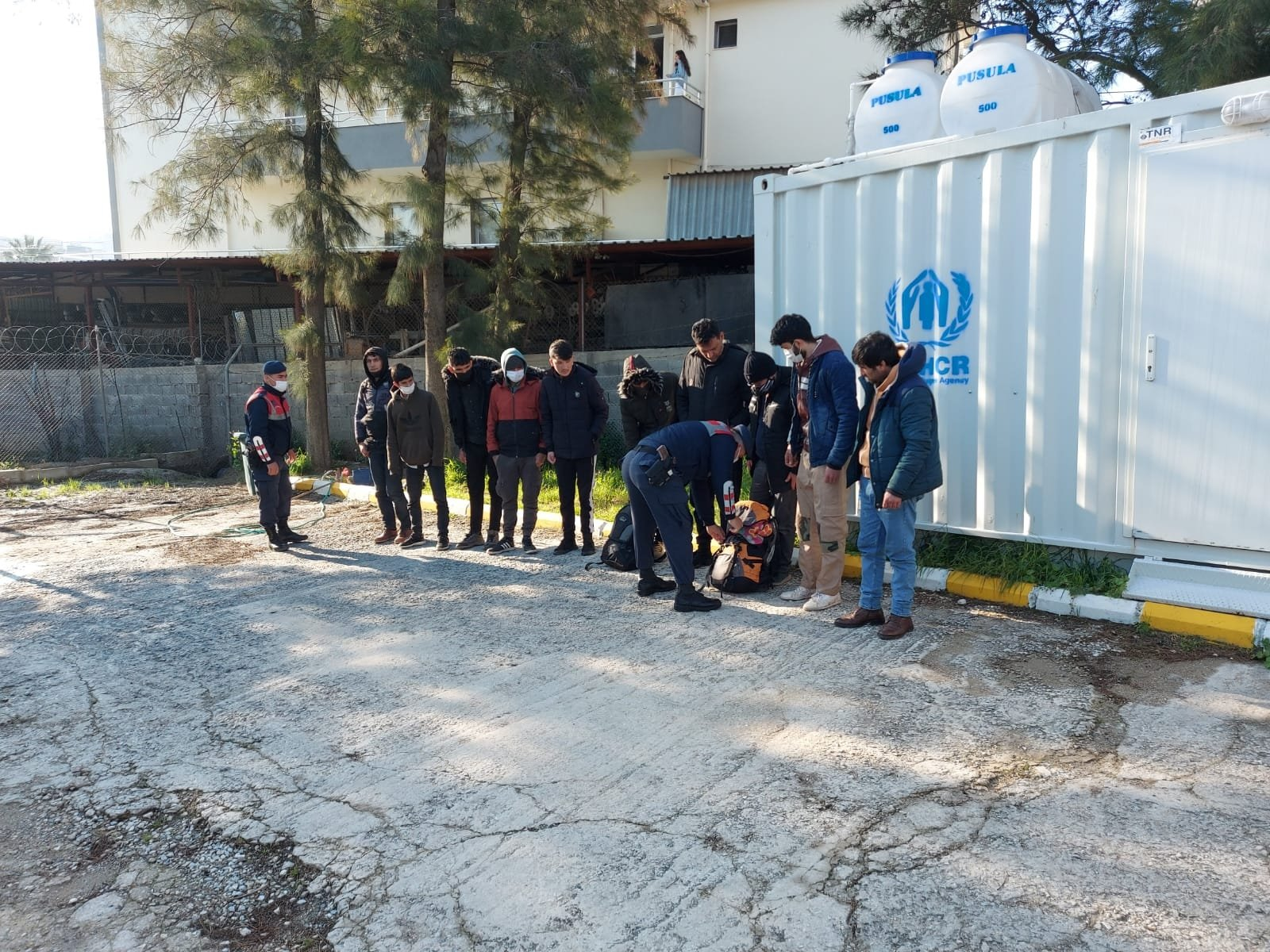 Gendarmerie forces caught several foreign nationals in Izmir province's Urla and Seferihisar districts, Aug. 11, 2021. (DHA Photo)
