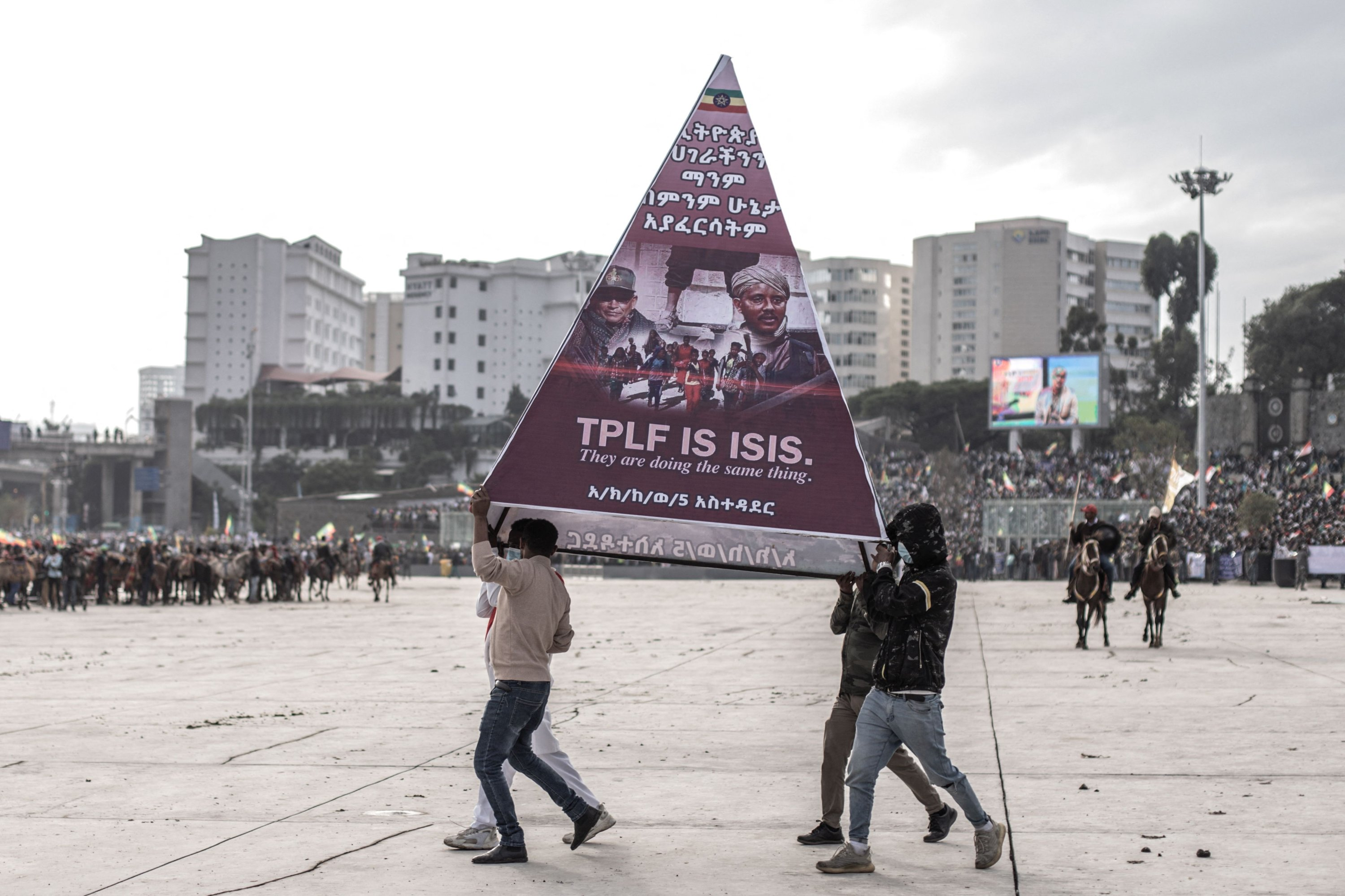 Protesters carry a banner during a rally against TPLF forces (Tigray People's Liberation Front) and in support of Ethiopia's armed forces in Addis Ababa on Aug. 8, 2021. (AFP Photo)