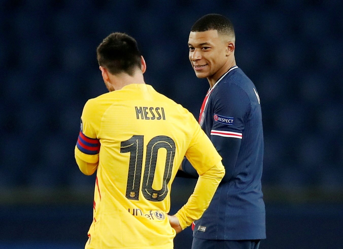 Lionel Messi talks with Kylian Mbappe during the second leg match of the Champions League Round of 16 match between Paris St Germain and FC Barcelona at Parc des Princes, Paris, France, March 10, 2021 (Reuters File Photo)
