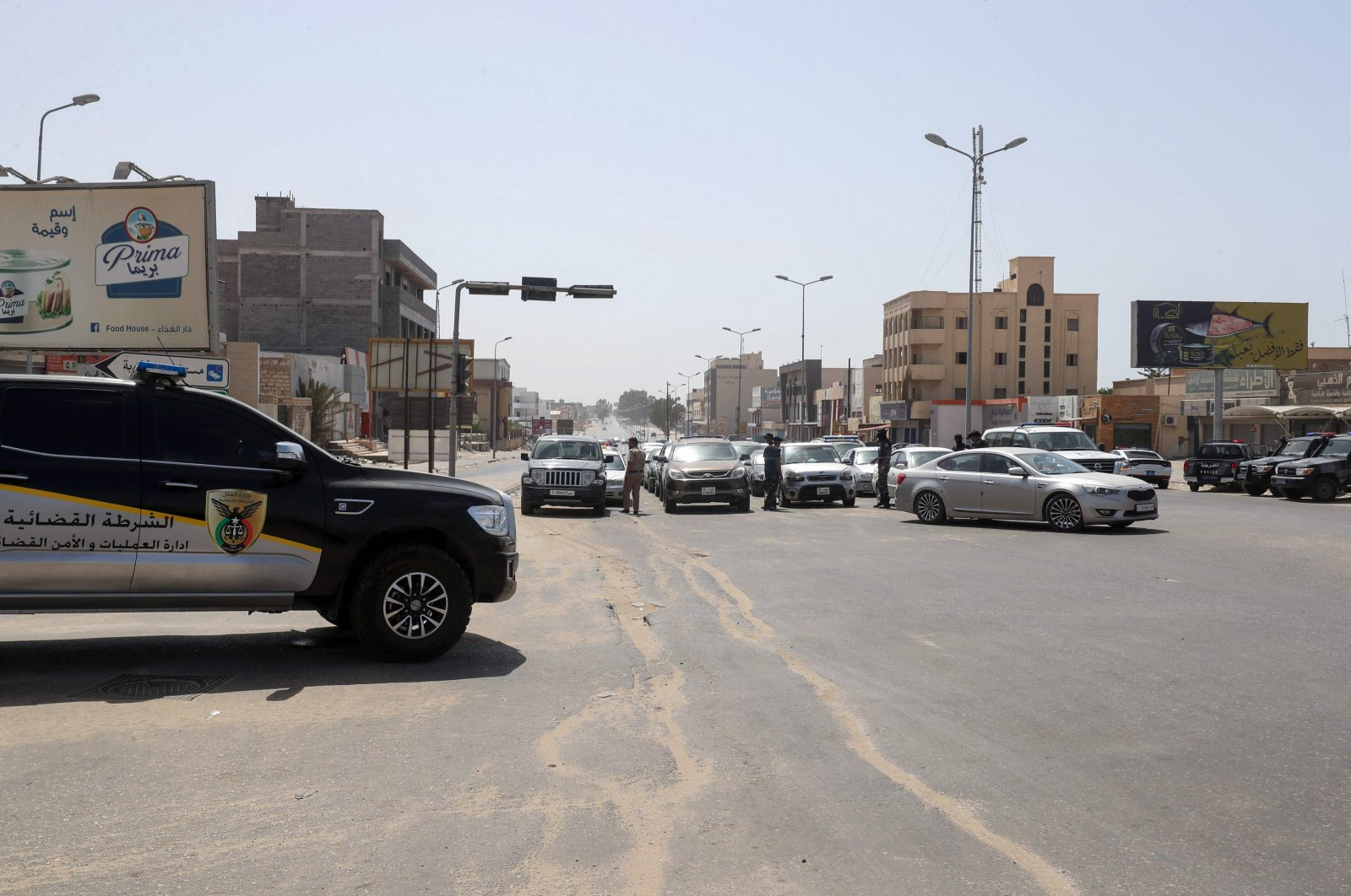 Libyan security officers man a check point to verify the implementation of a total curfew the authorities announced a day earlier, to mitigate the spread of the COVID-19 pandemic, in the capital Tripoli, Libya, on Aug. 7, 2021. (AFP Photo)