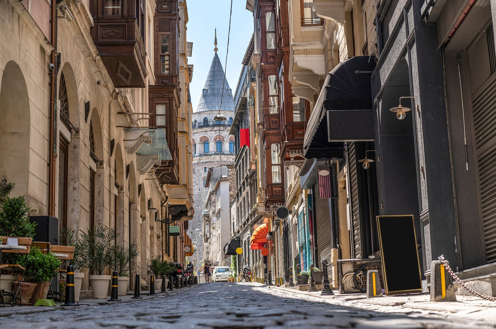 The Galata Tower is seen between historical buildings. (Shutterstock Photo)