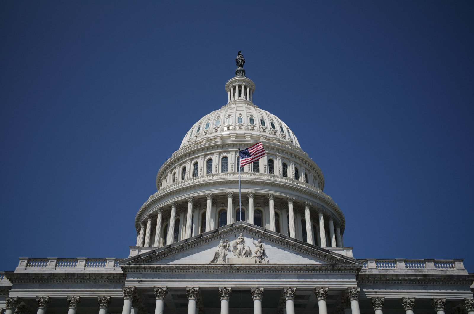 The national flag flies over the U.S. Capitol in Washington, D.C., U.S., Aug. 8, 2021. (AFP Photo)