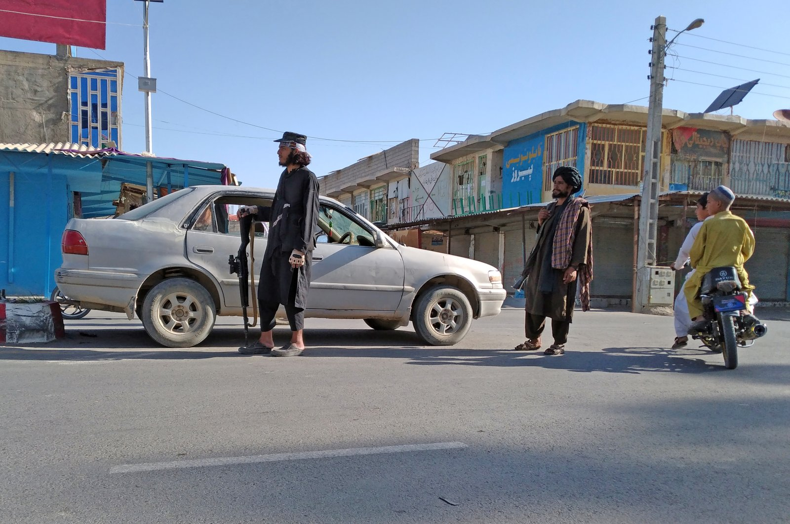 Taliban fighters stand guard at a checkpoint inside the city of Farah, capital of Farah province southwest of Kabul, Afghanistan, Aug. 11, 2021. (AP Photo)