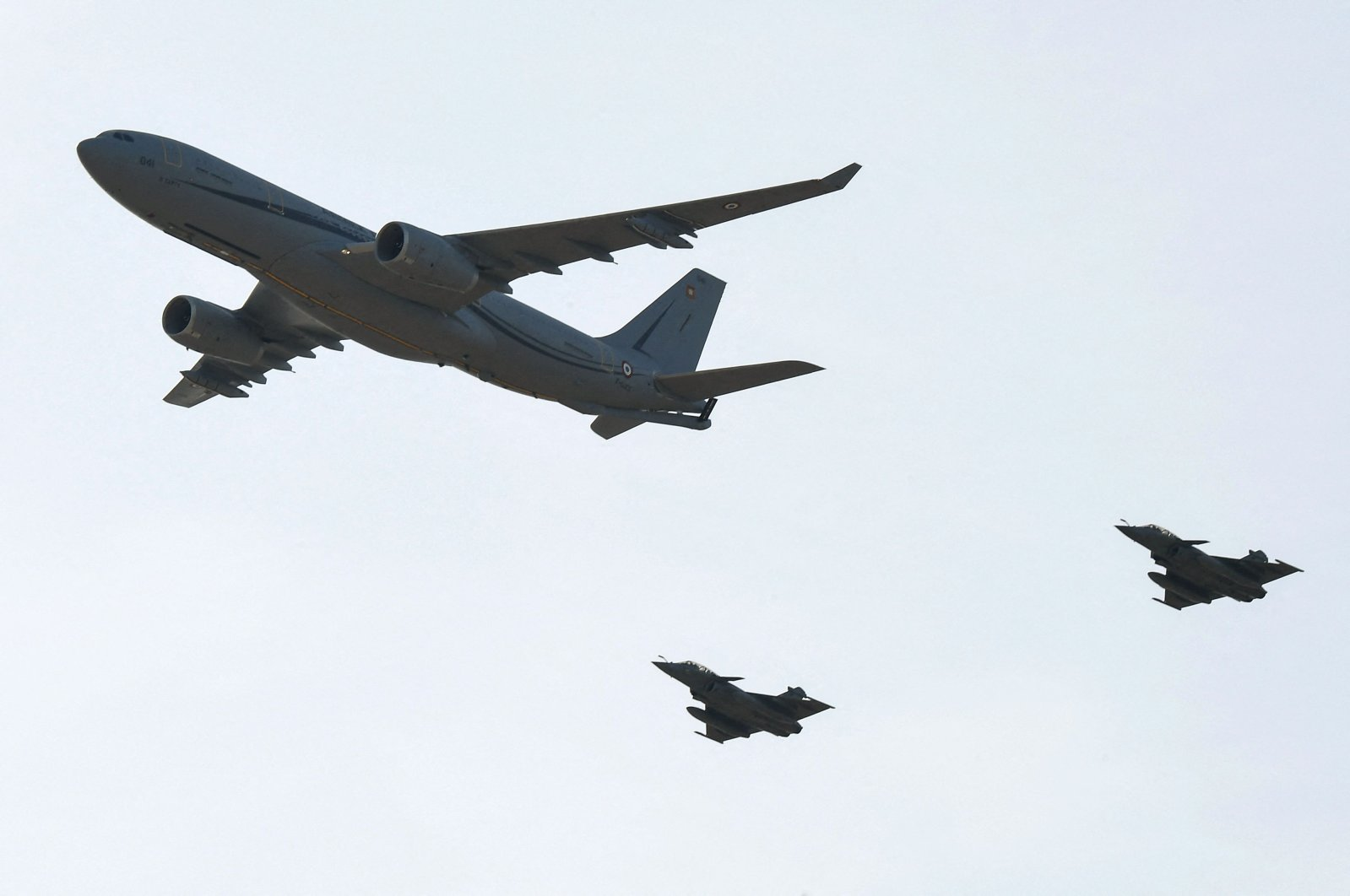 A French Air Force new Airbus A330 Multi Role Tanker Transport (MRTT) phoenix aircraft (L), and its two Rafale escort jets, fly over the Istres military base in southern France, Oct. 19, 2018. (AFP Photo)