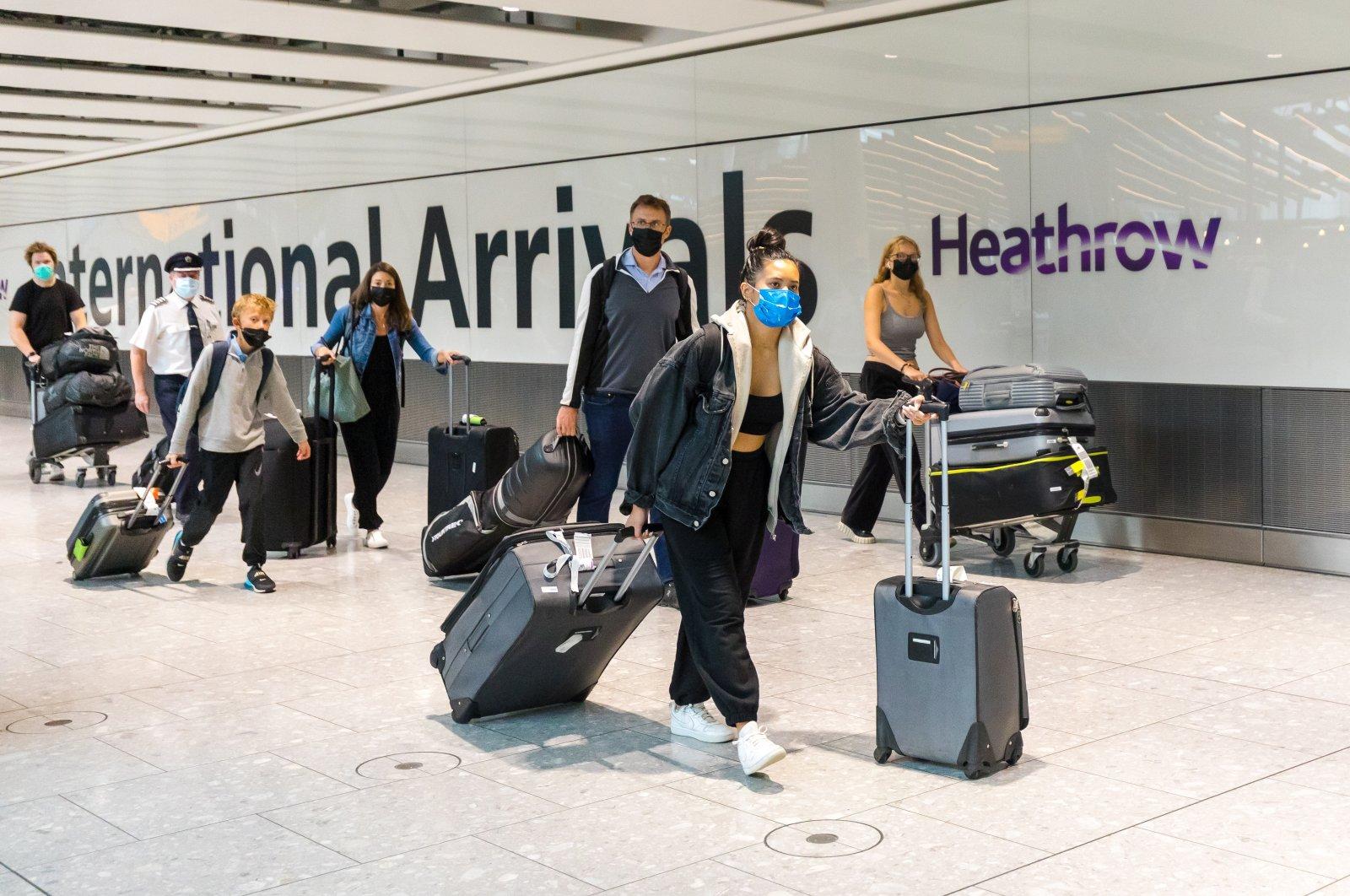 Passengers arrive at Heathrow Airport in London, U.K., Aug. 2, 2021. (EPA Photo)