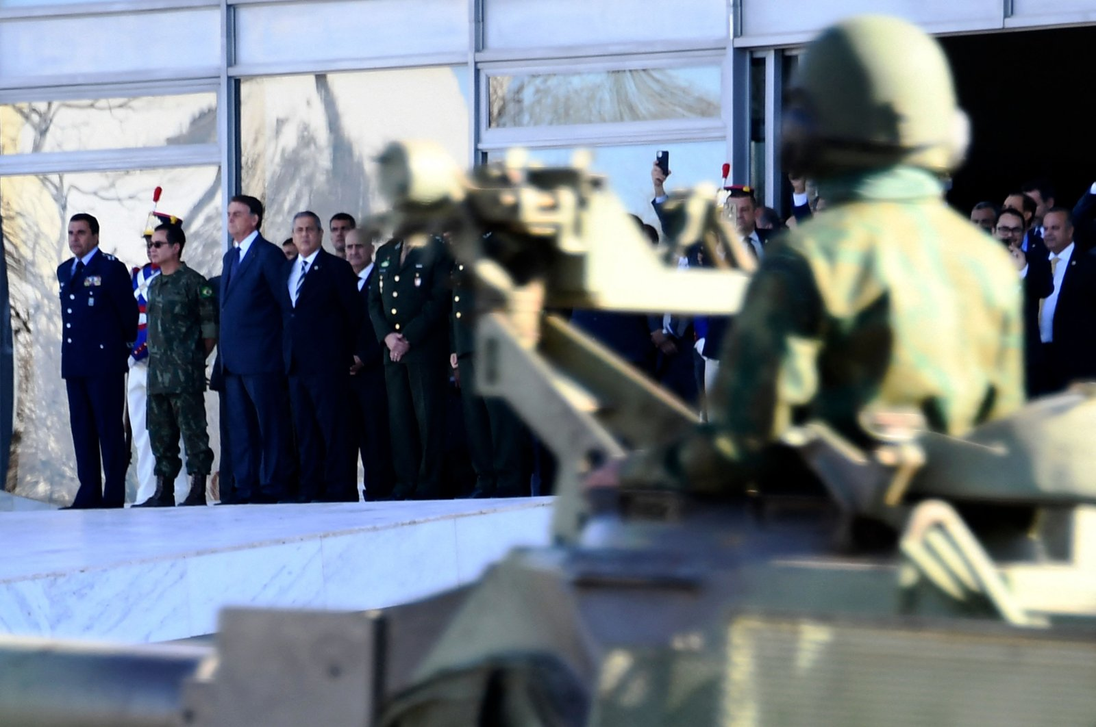 Brazilian President Jair Bolsonaro, accompanied by ministers and military commanders, attends a military parade in front of the Planalto Palace in Brasilia, Brazil, on Aug. 10, 2021. (AFP Photo)