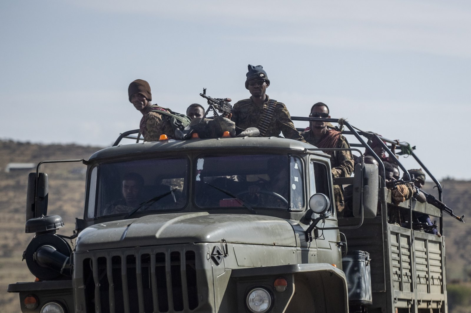 Ethiopian government soldiers ride in the back of a truck on a road near Agula, north of Mekele, in the Tigray region of northern Ethiopia on May 8, 2021. (AP Photo)