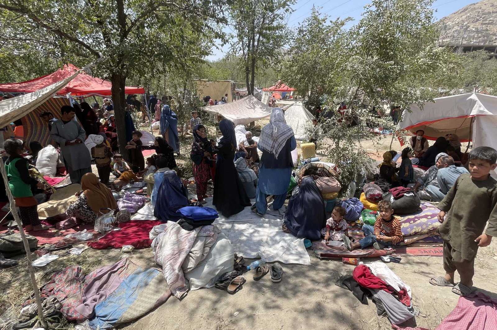 Afghan migrants, who left their homes due to the clashes between Afghan government forces and the Taliban, survive under difficult conditions in a park with makeshift tents they set up in the capital, Kabul, Afghanistan, on Aug. 8, 2021. (AA Photo)