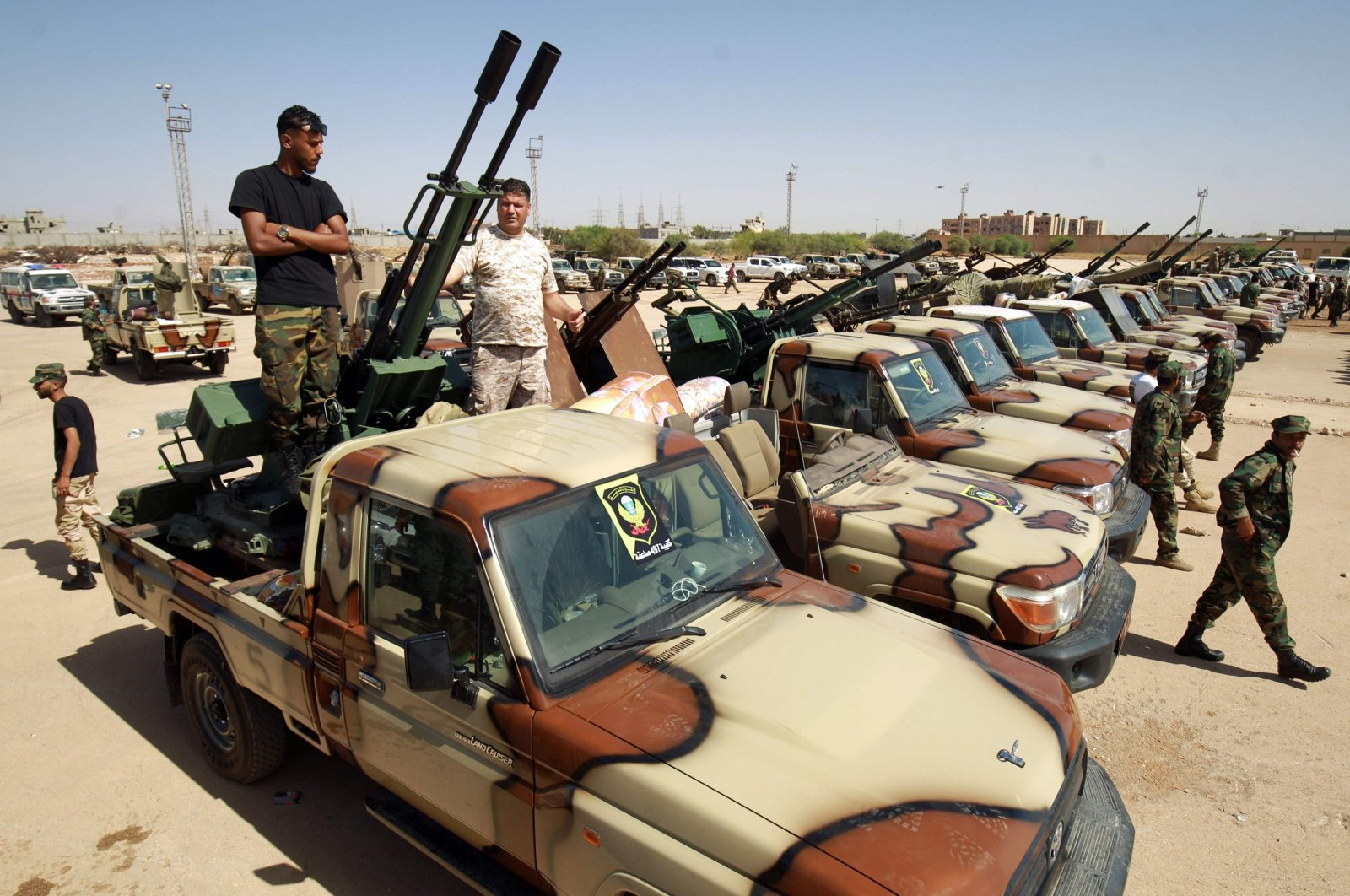 Forces loyal to putschist Gen. Khalifa Haftar gather in the city of Benghazi, on their way to back up fellow fighters on the front line west of the city of Sirte, Libya, June 18, 2020. (AFP Photo)