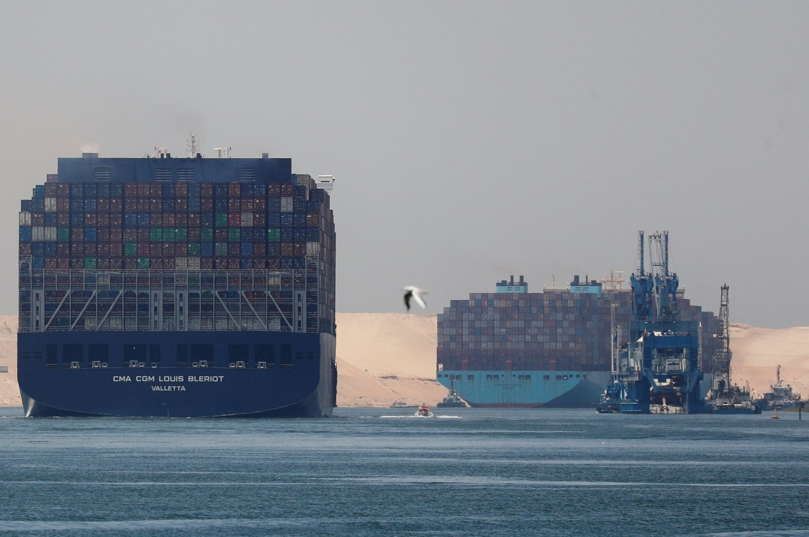 CMA CGM Louis Bleriot and a Maersk Line container ship pass through the Suez Canal in Ismailia, Egypt, July 7, 2021. (Reuters Photo)