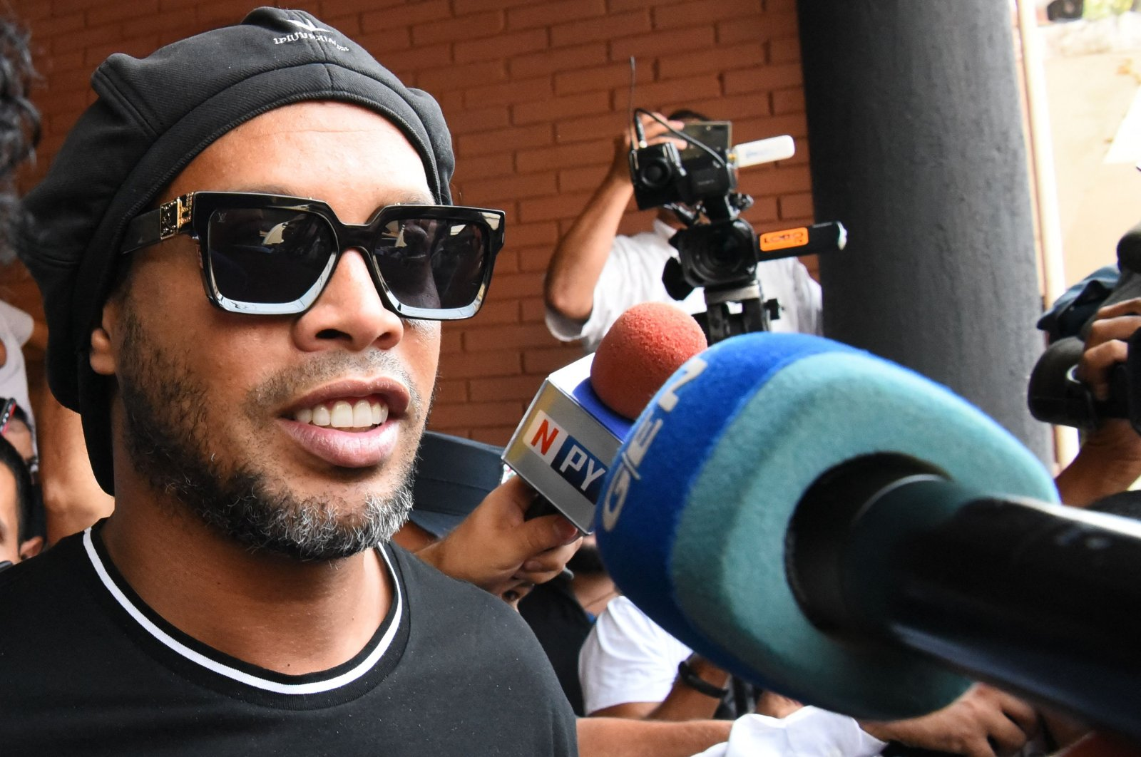 Former Brazilian footballer Ronaldinho leaves Asuncion's Prosecution after declaring about his irregular entry to the country, in Asuncion, Paraguay, March 05, 2020. (AFP Photo)