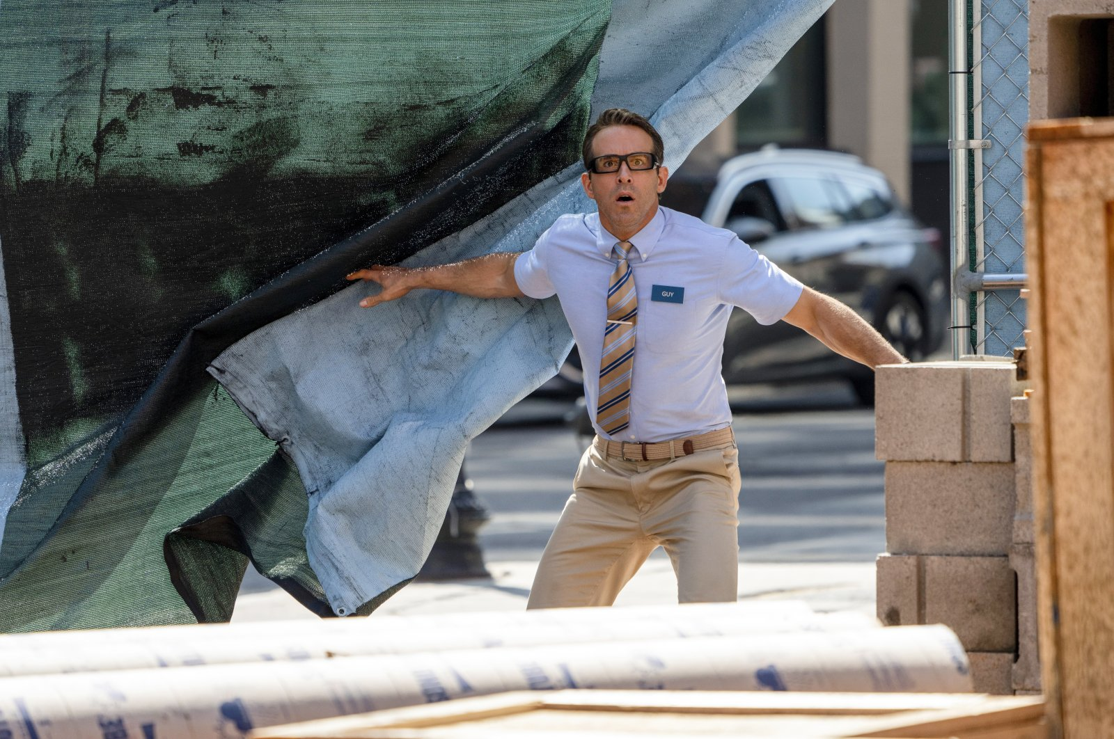 """This image released by 20th Century Studios shows Ryan Reynolds in a scene from """"Free Guy."""" (AP Photo)"""