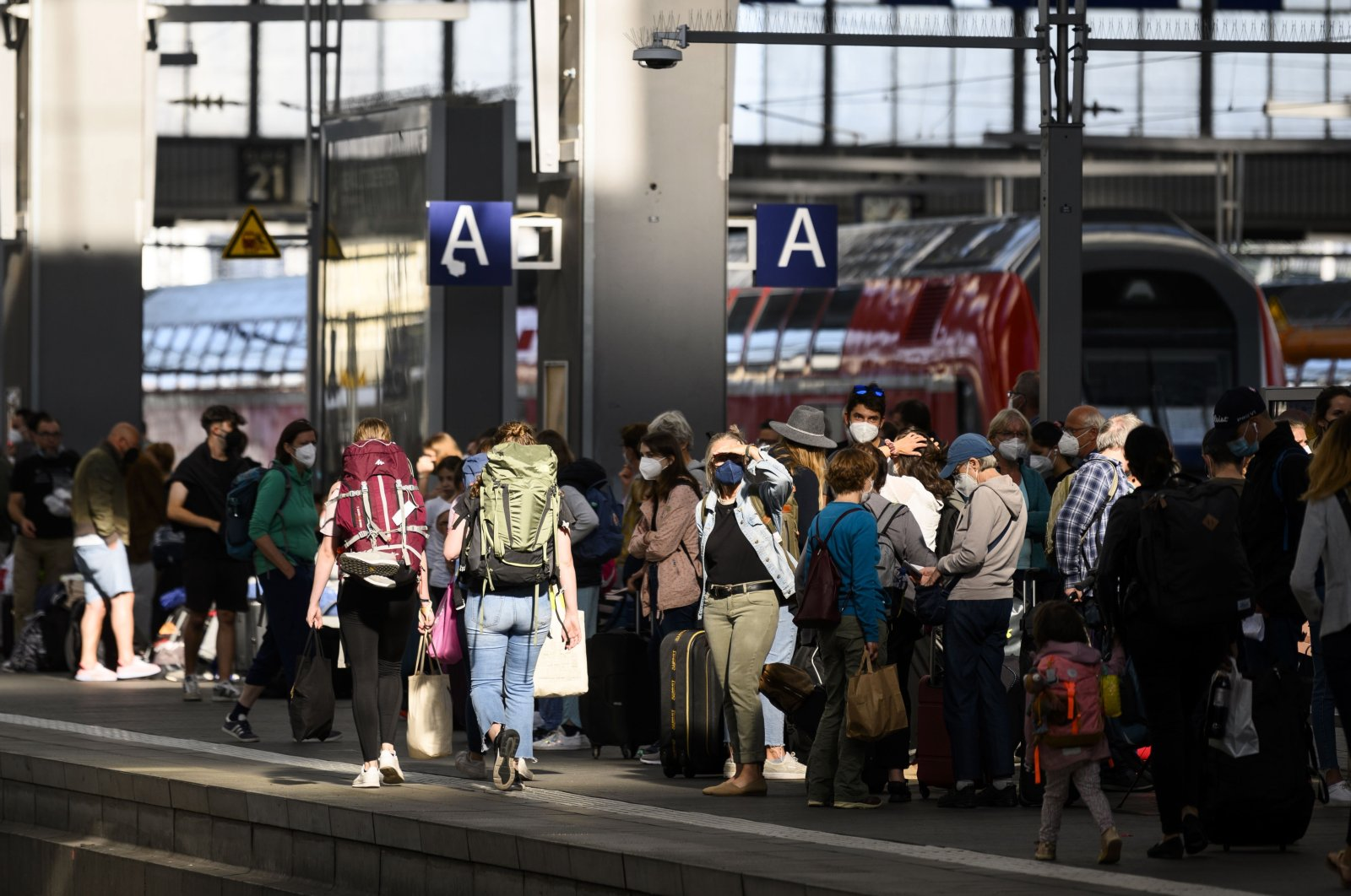 Travelers wait during a warning strike in railway operations in Germany at Central Railway Station in Munich, Germany, Aug. 11, 2021. (EPA Photo)