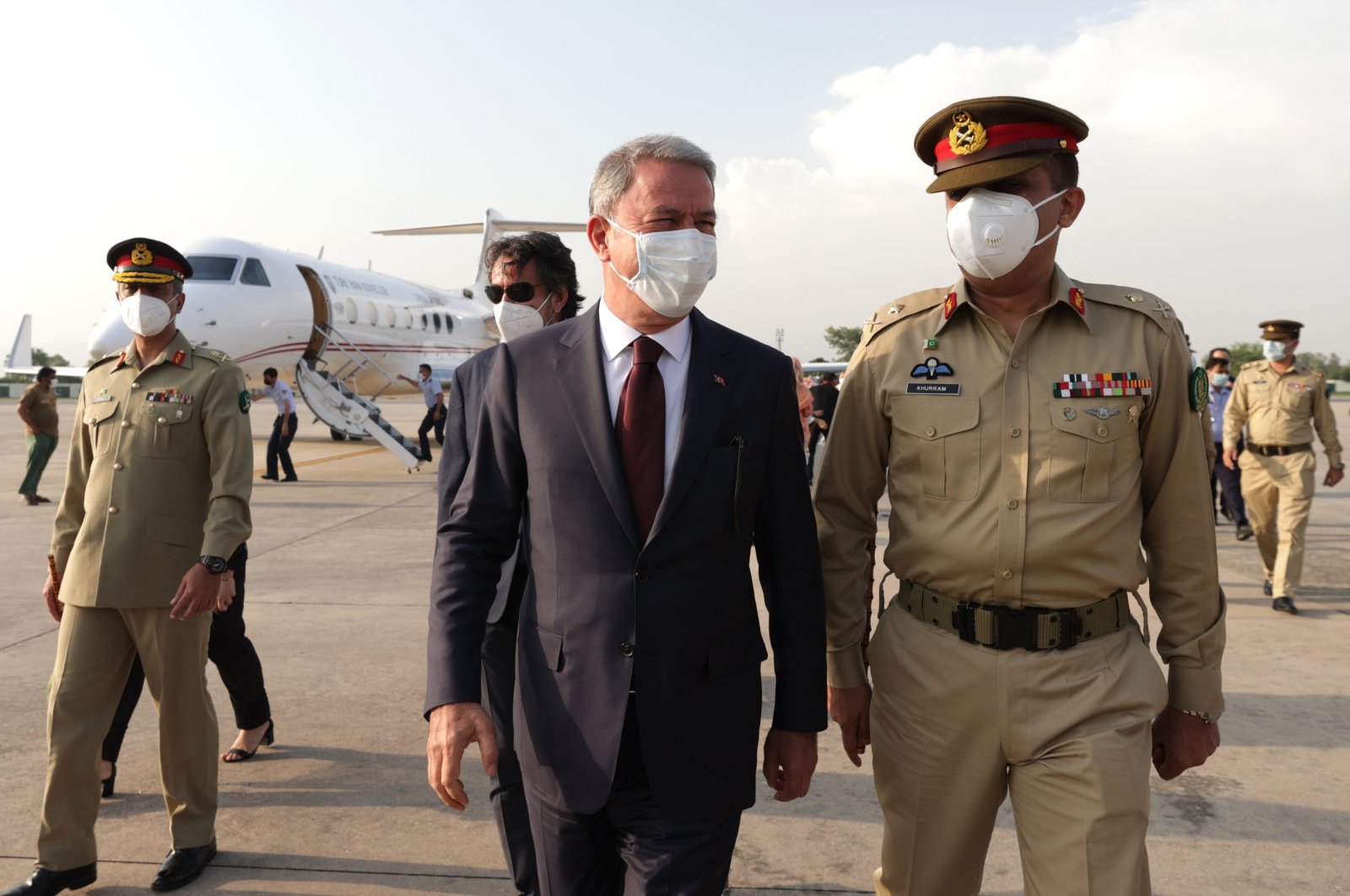 Turkey's Defense Minister Hulusi Akar (L) is received by Pakistani authorities at the airport in Islamabad, Pakistan, Aug. 10, 2021. (AA Photo)