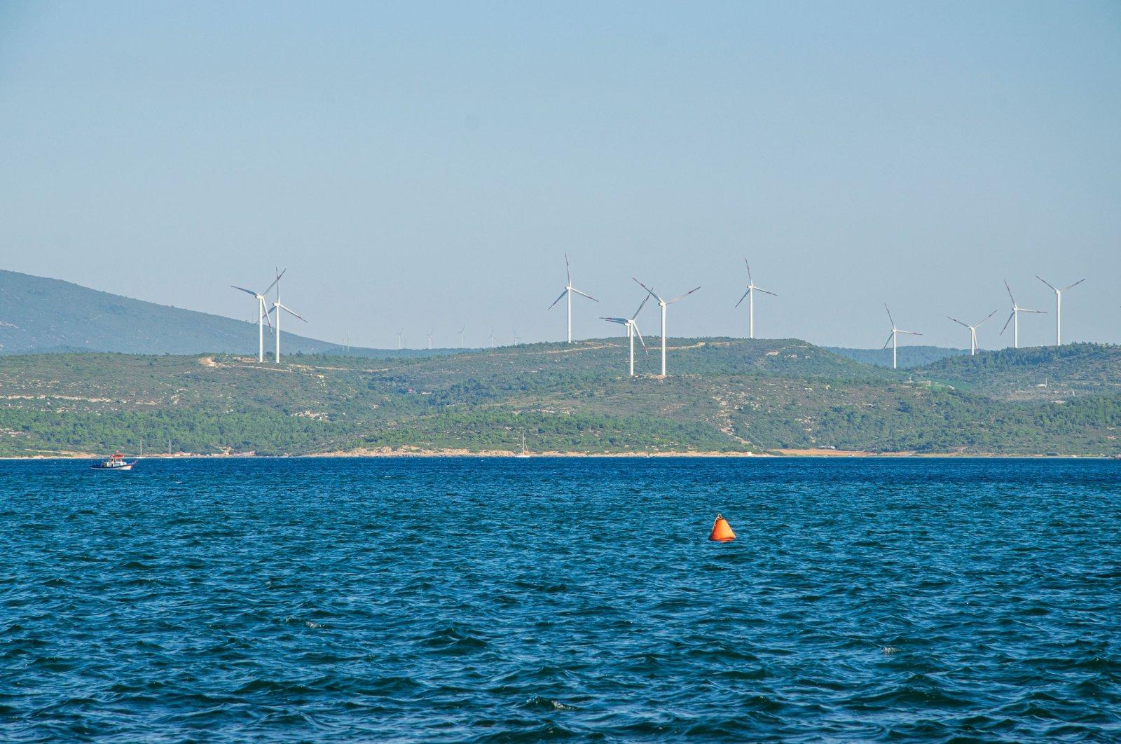 Wind turbines are seen in Sığacık, a seaside neighborhood of Seferihisar district in the western province of Izmir, Turkey, Dec. 14, 2020. (Shutterstock Photo)