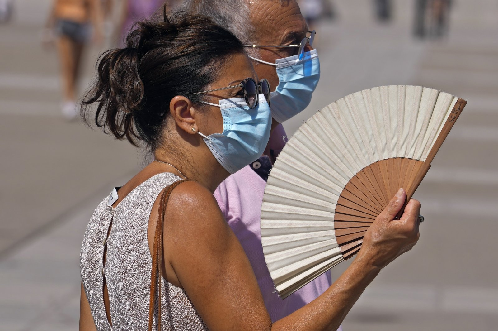 A woman fans herself in Madrid, Spain, Aug. 10, 2021. (AP Photo)