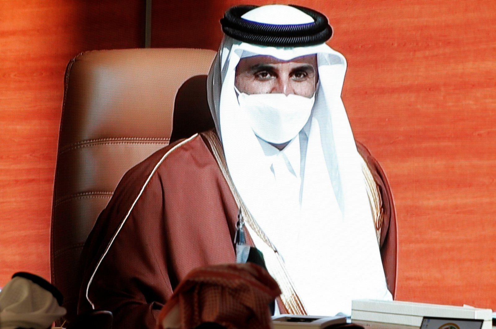 Qatar's Emir Sheikh Tamim bin Hamad Al Thani is pictured via screen as he attends the Gulf Cooperation Council's (GCC) 41st Summit, in Al Ula, Saudi Arabia Jan. 5, 2021. (REUTERS Photo)