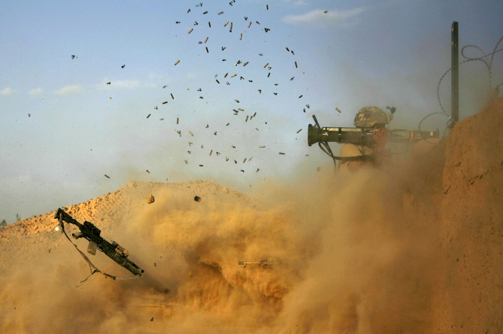 US army soldier with the 101st Airborne Division Alpha Battery 1-320th fires an AT-4 as Combat Outpost Nolen on the outskirts of the village of Jellawar in the Arghandab Valley came under Taliban attack, September 11, 2010. (AFP Photo)